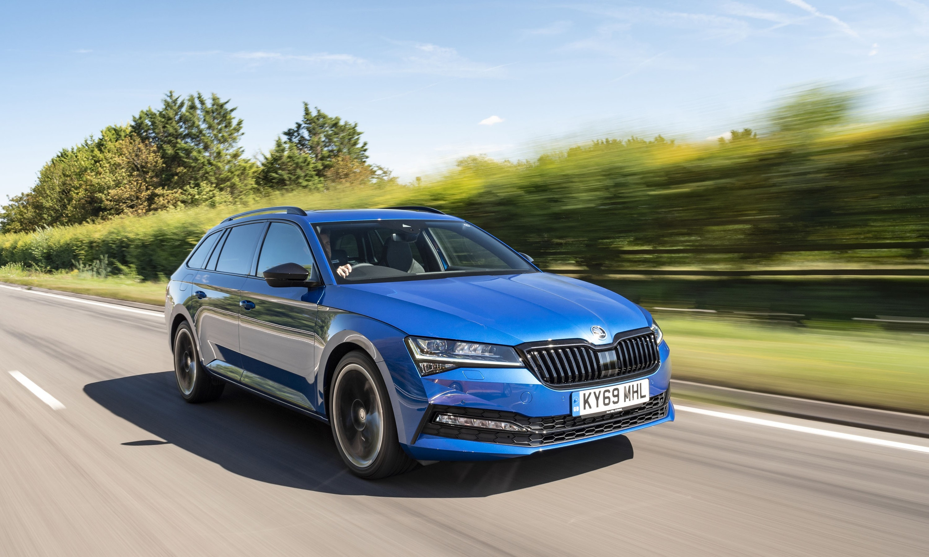 Skoda Superb driving on a road