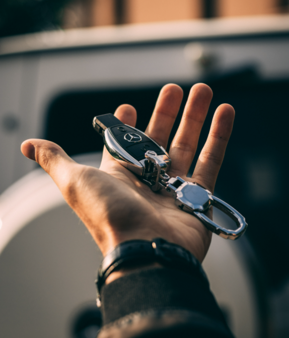 man holding mercedes car keys