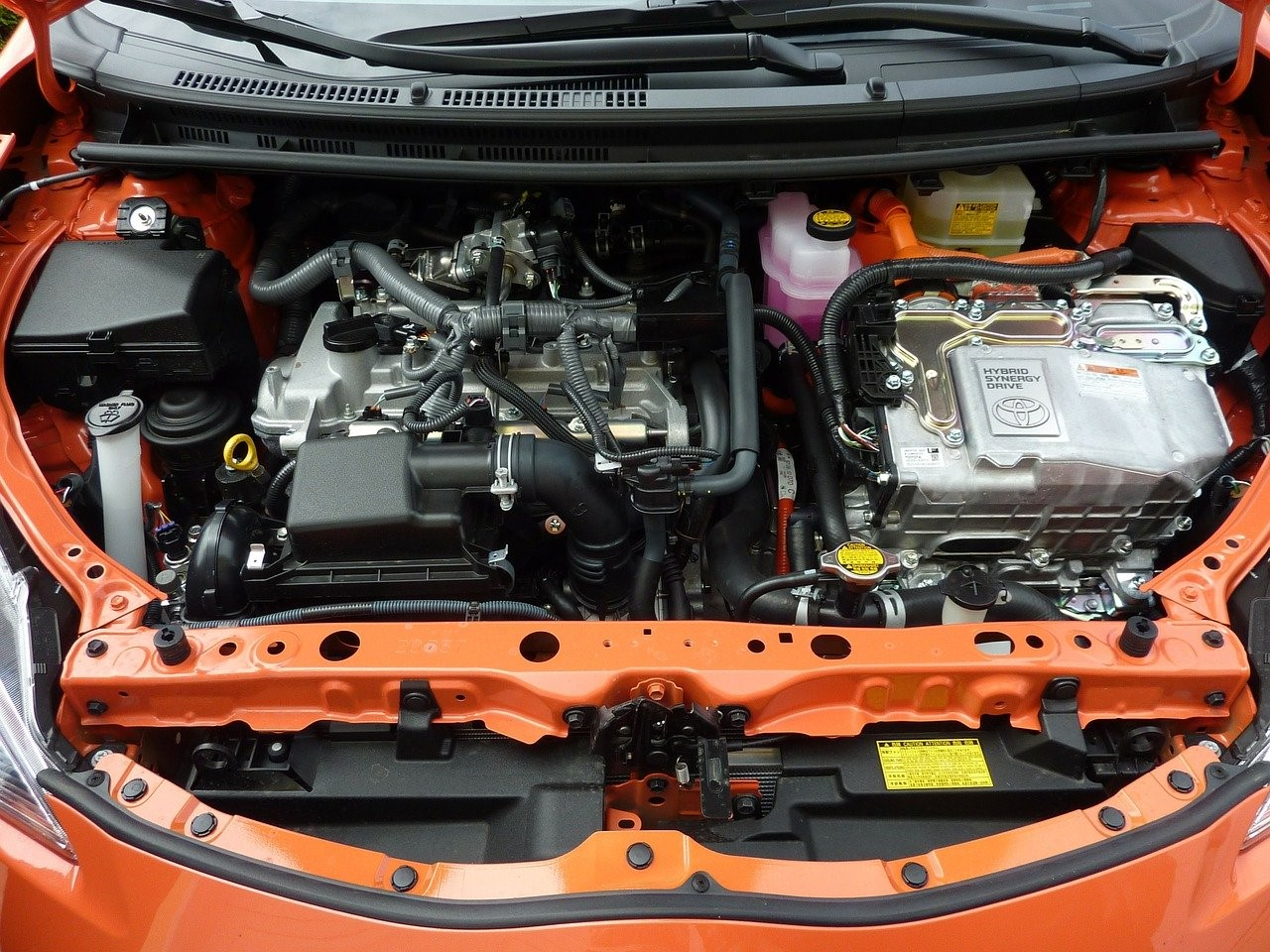 under the bonnet of an orange car