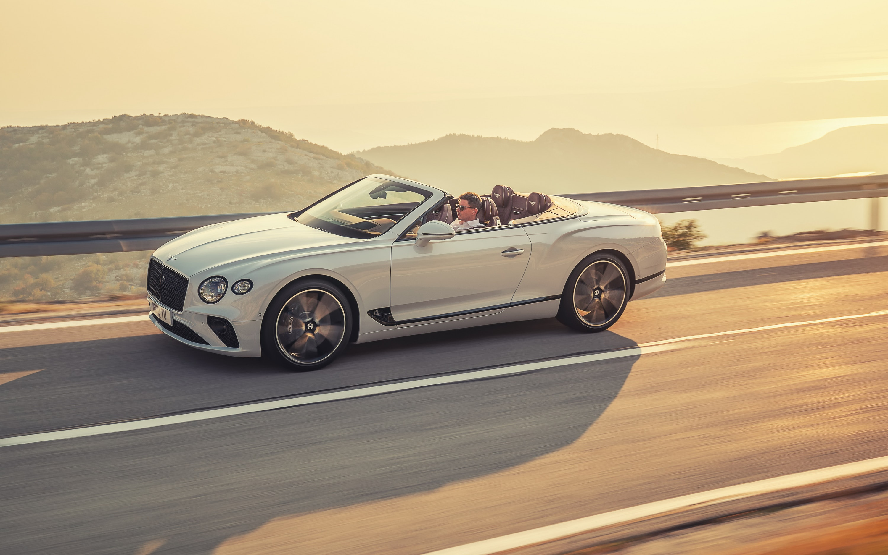 Bentley Continental GT Convertible driving on a road