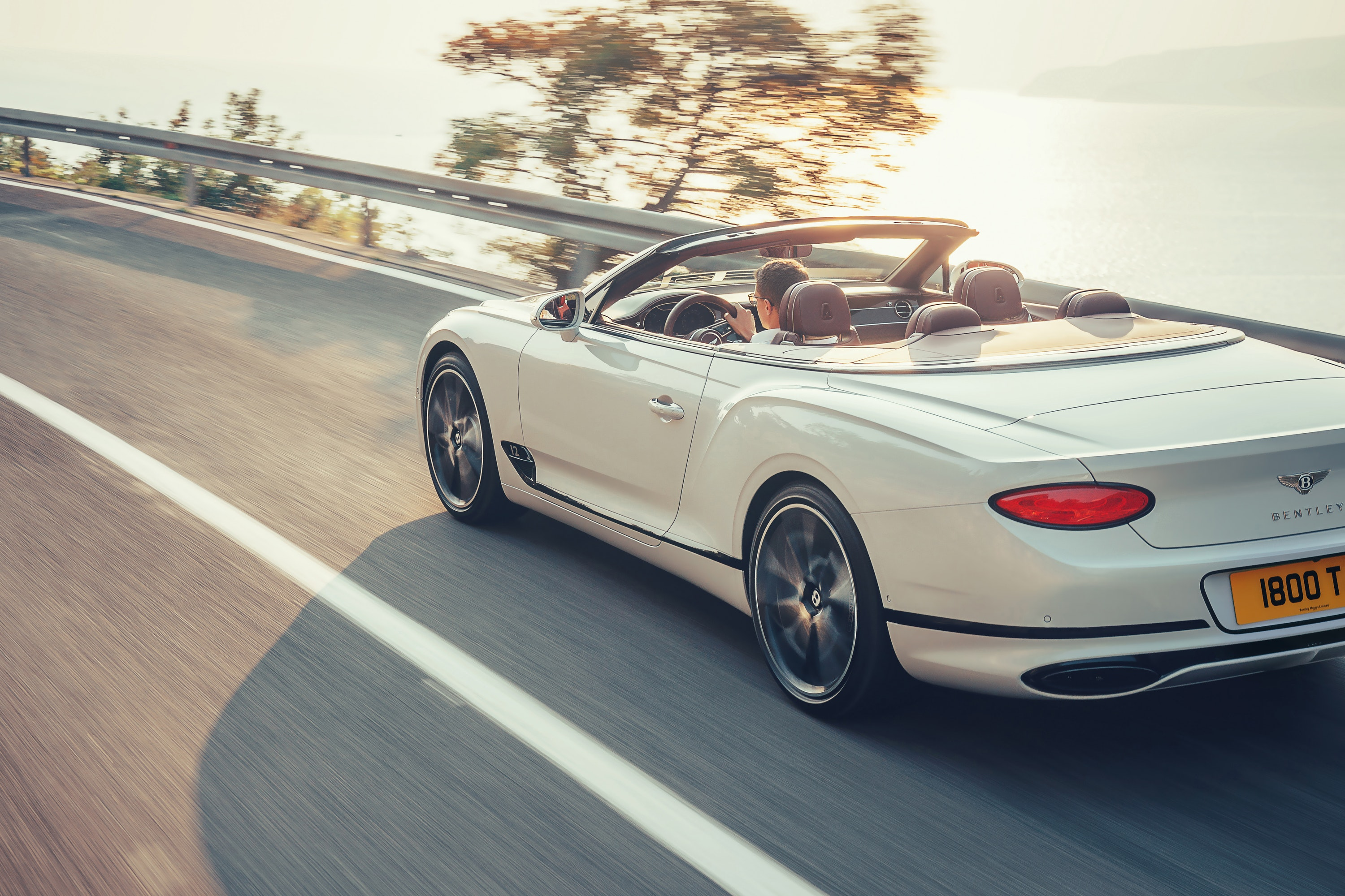 Bentley Continental GT Convertible driving with the roof down
