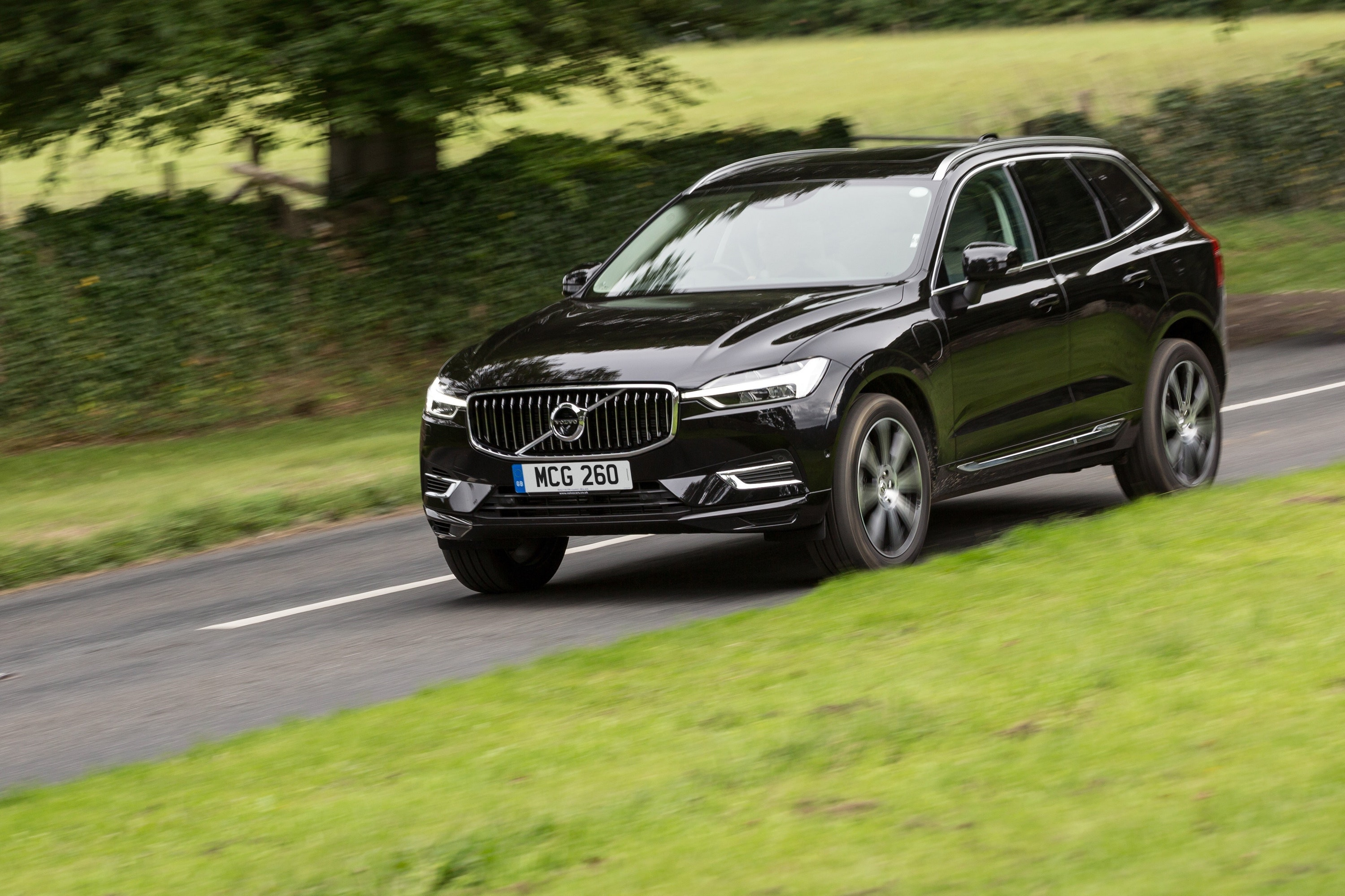Black Volvo XC60 T8 driving on a road