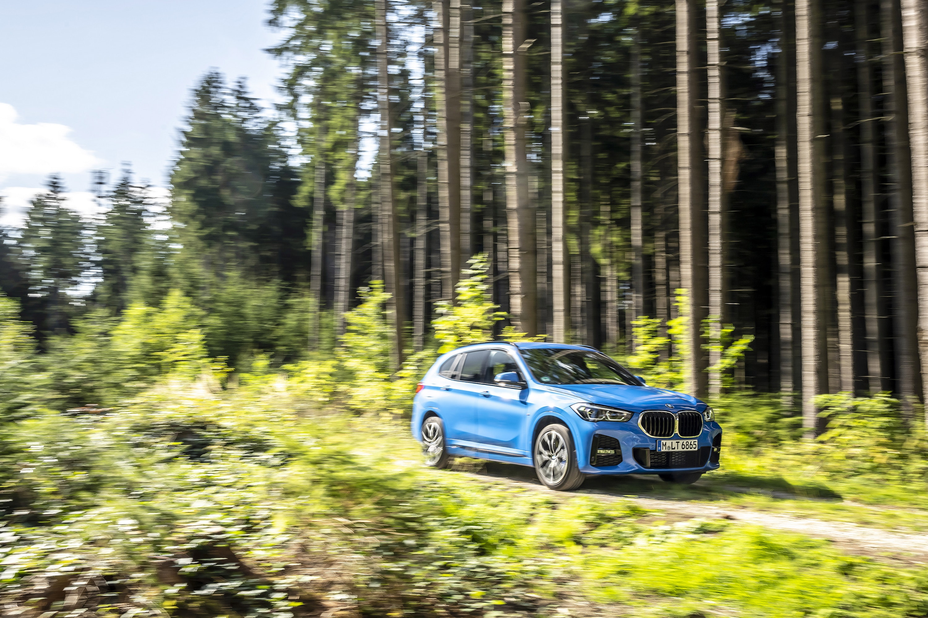 BMW X1 Driving through the woods