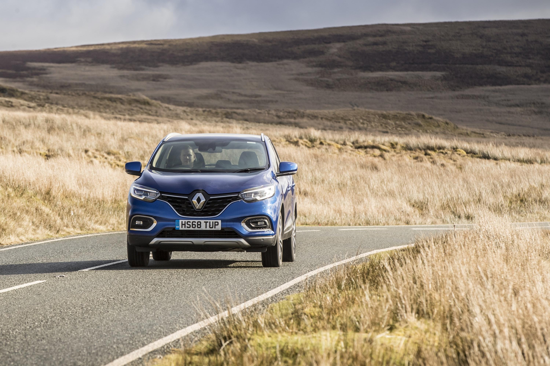 close up of Renault Kadjar driving on a road