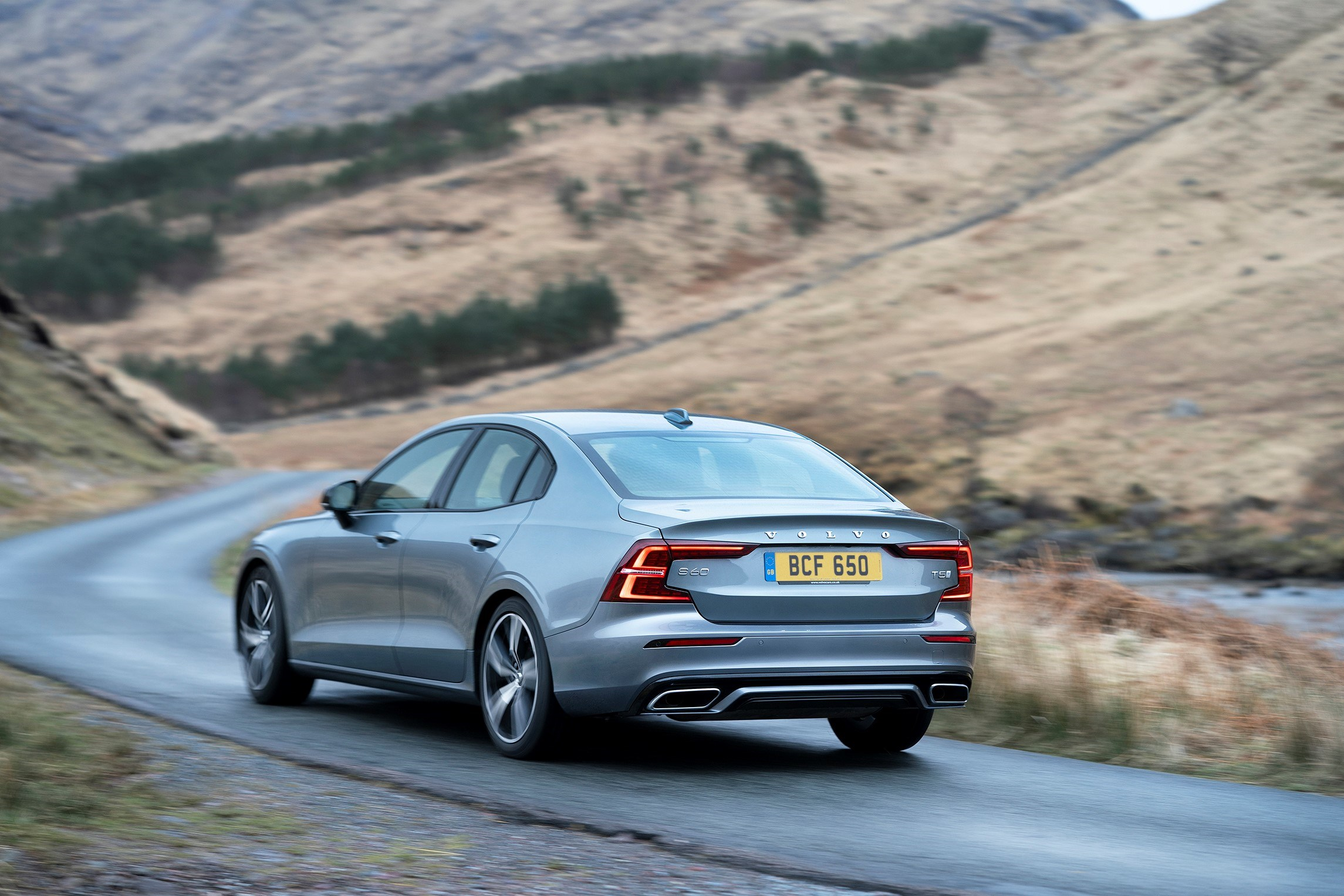 Rear view of a Volvo S60 driving on a road