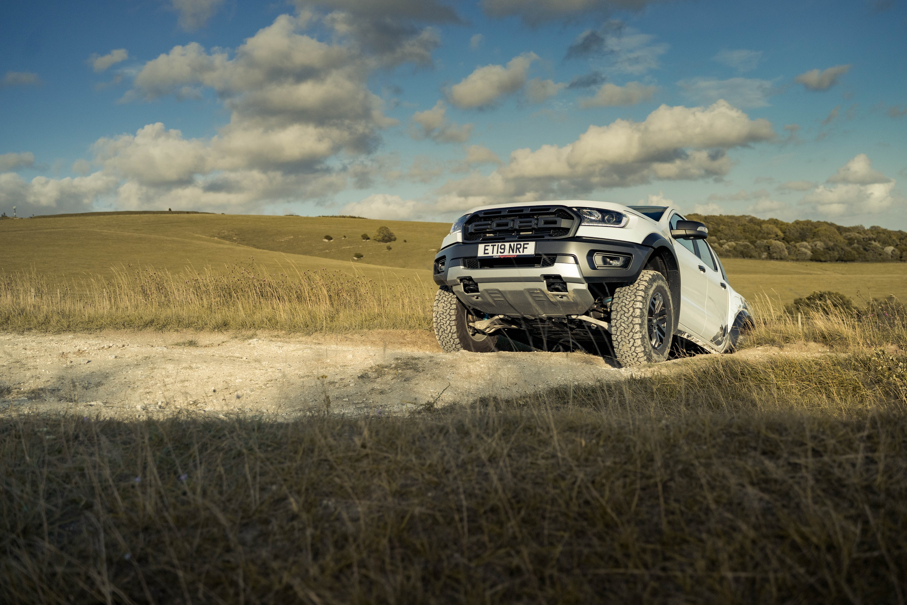 Ford Range Raptor driving on dirt terrain