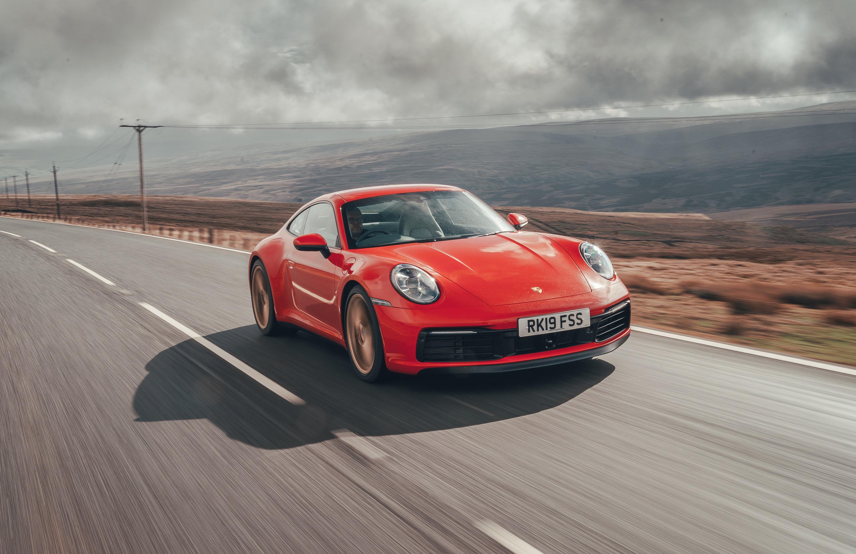 driving red Porsche