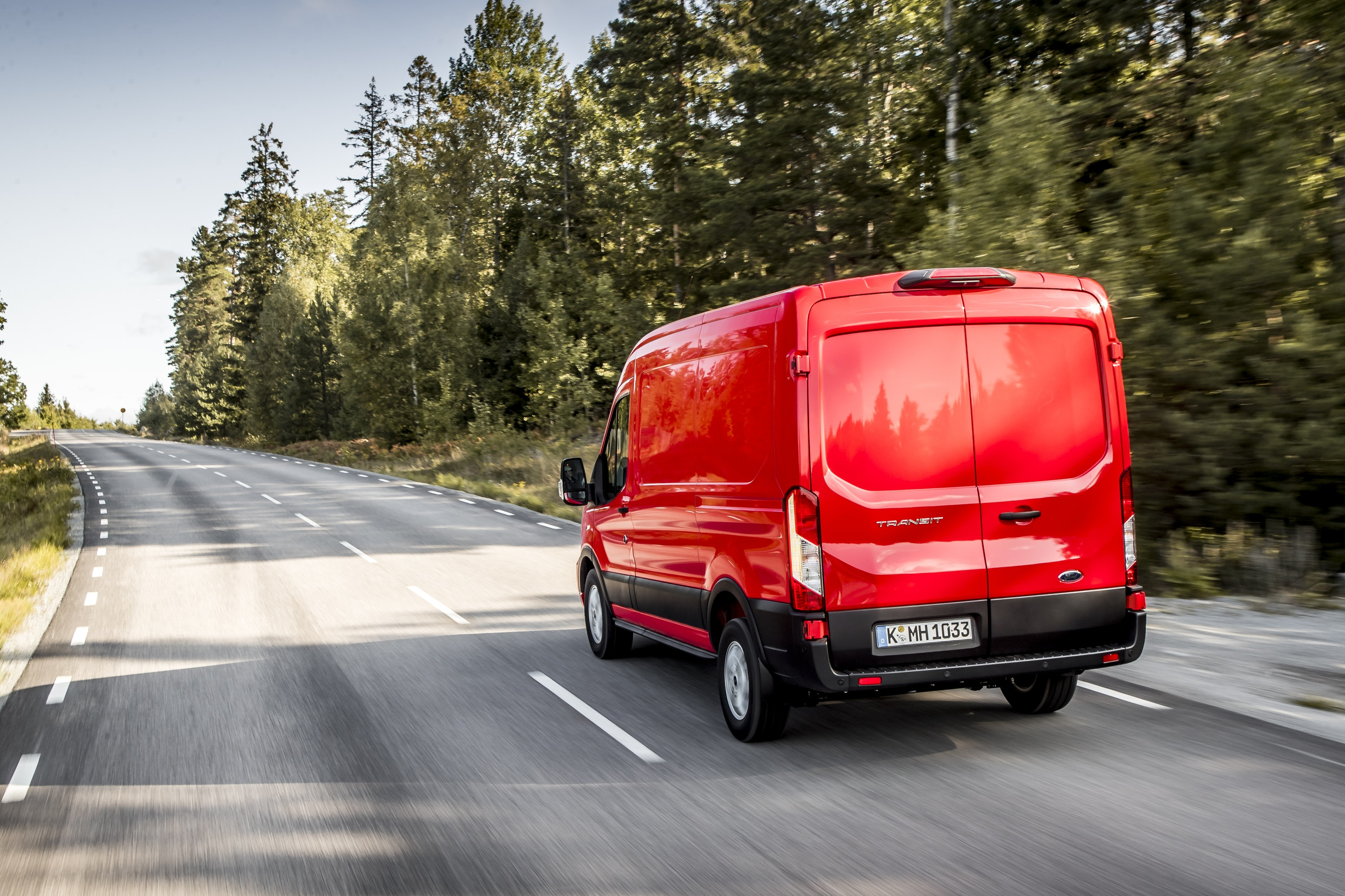 Rear view of a Red Ford Transit