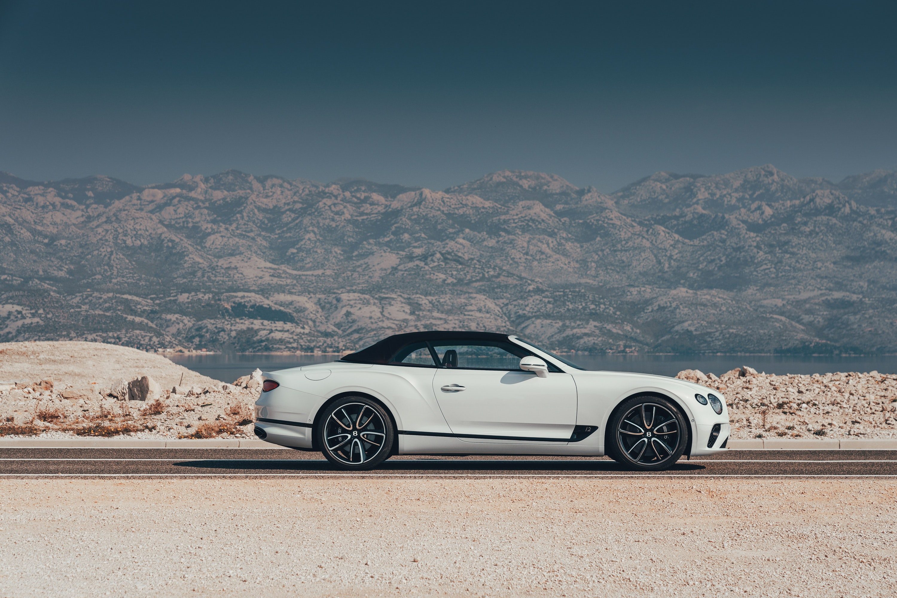 side view of  Bentley Continental GT Convertible with the roof up