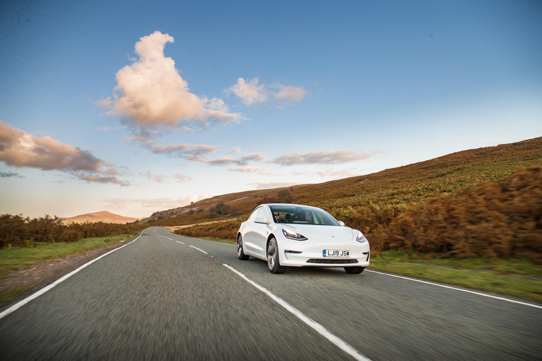 driving Tesla white
