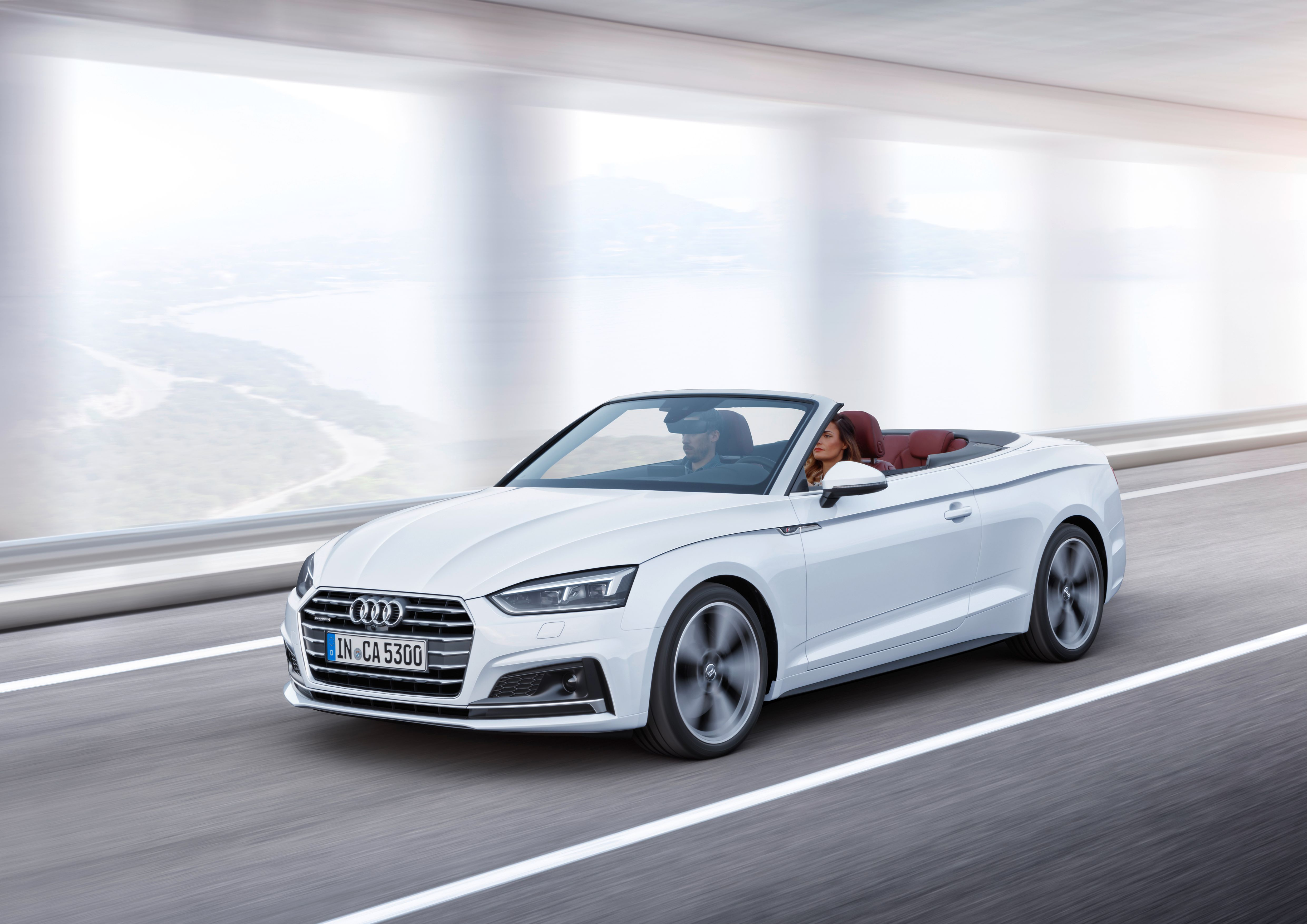 White Audi A5 Cabriolet whizzing along with the roof down