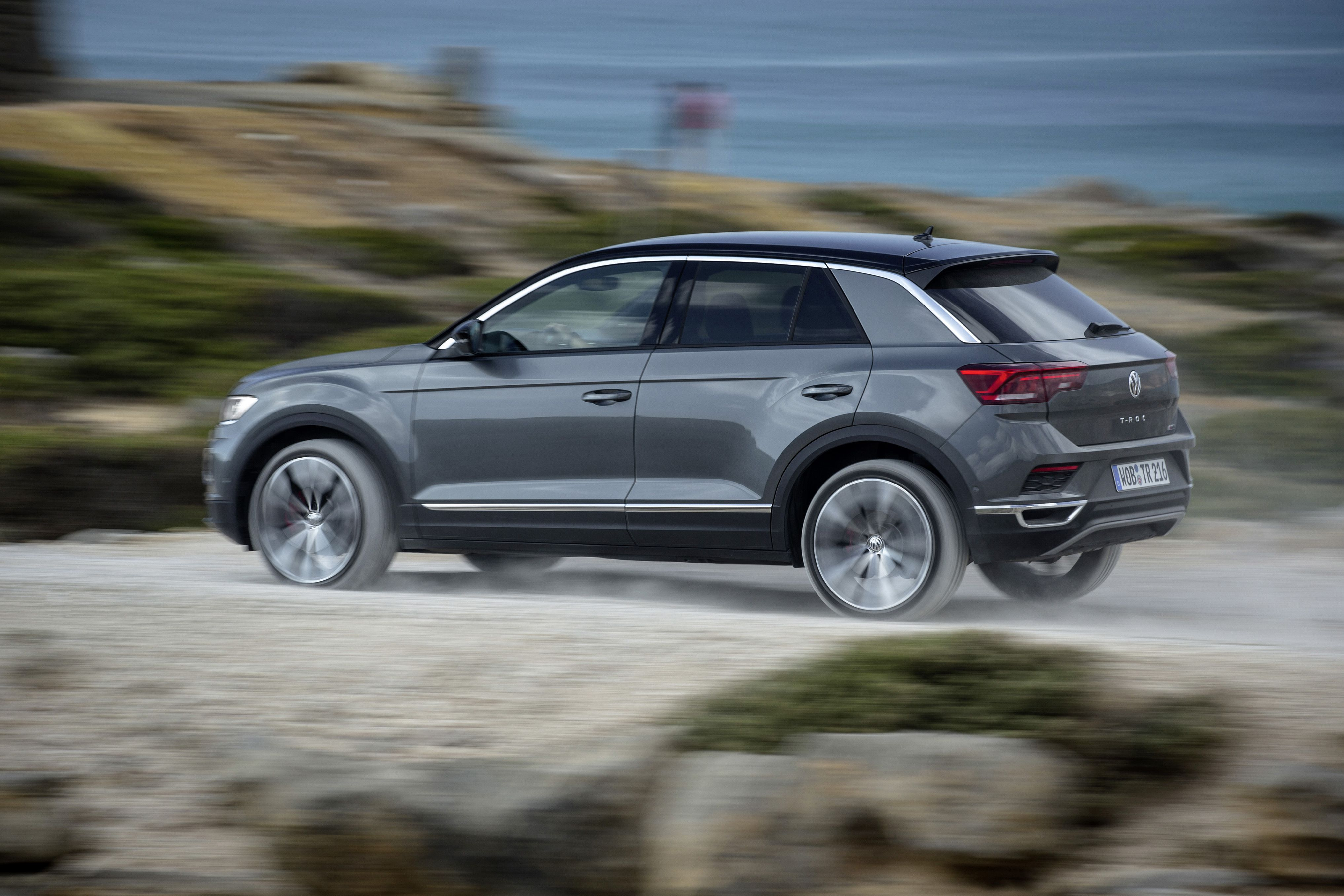 Metallic VW T-Roc driving away from you at speed