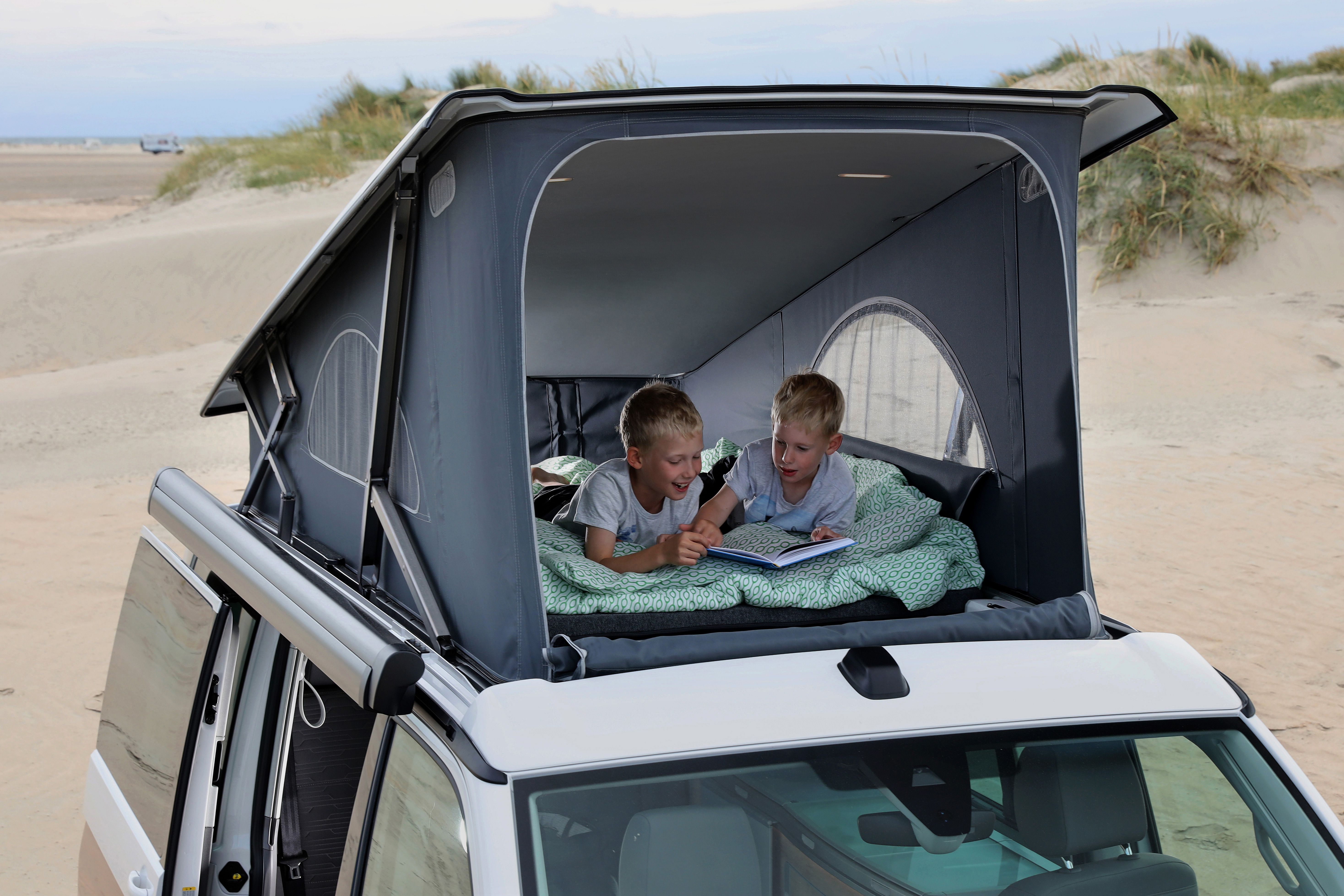 Two little boys in upper bed of VW California