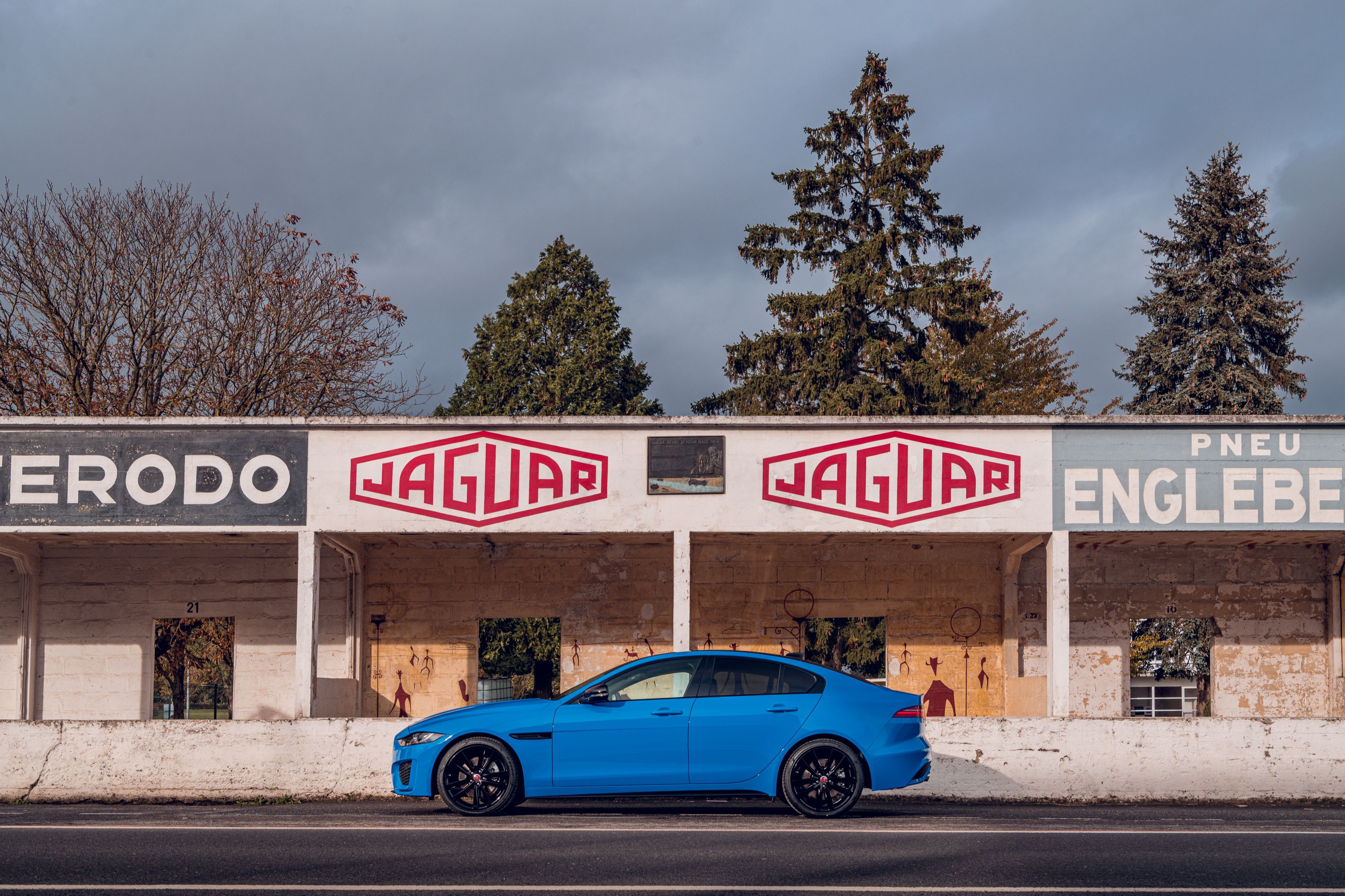 Side view of blue Jaguar XE Reim