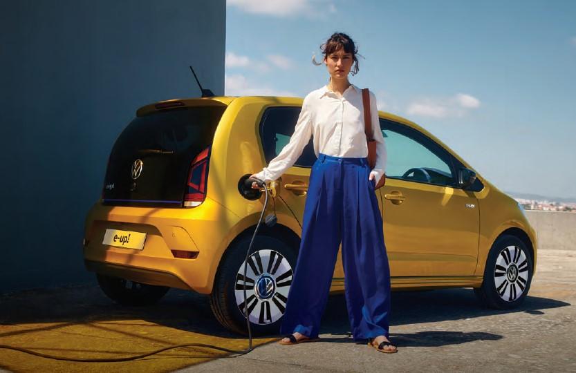 Women charging volkswagen e-up