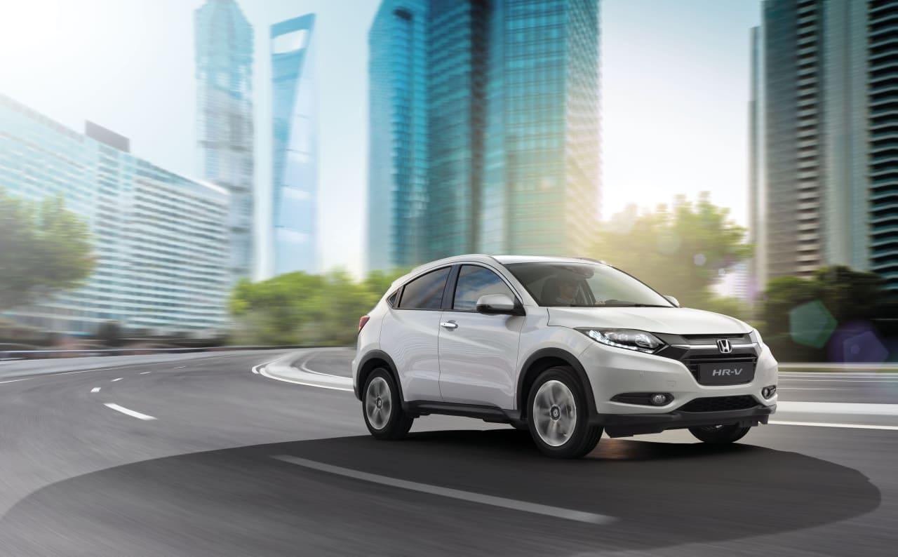 White Honda HR-V driving on a road