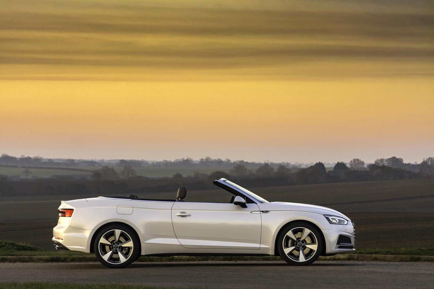 Silver Audi A5 Cabriolet side on at sunset