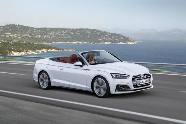 White Audi A5 Cabriolet on coast road with roof down and gorgeous view
