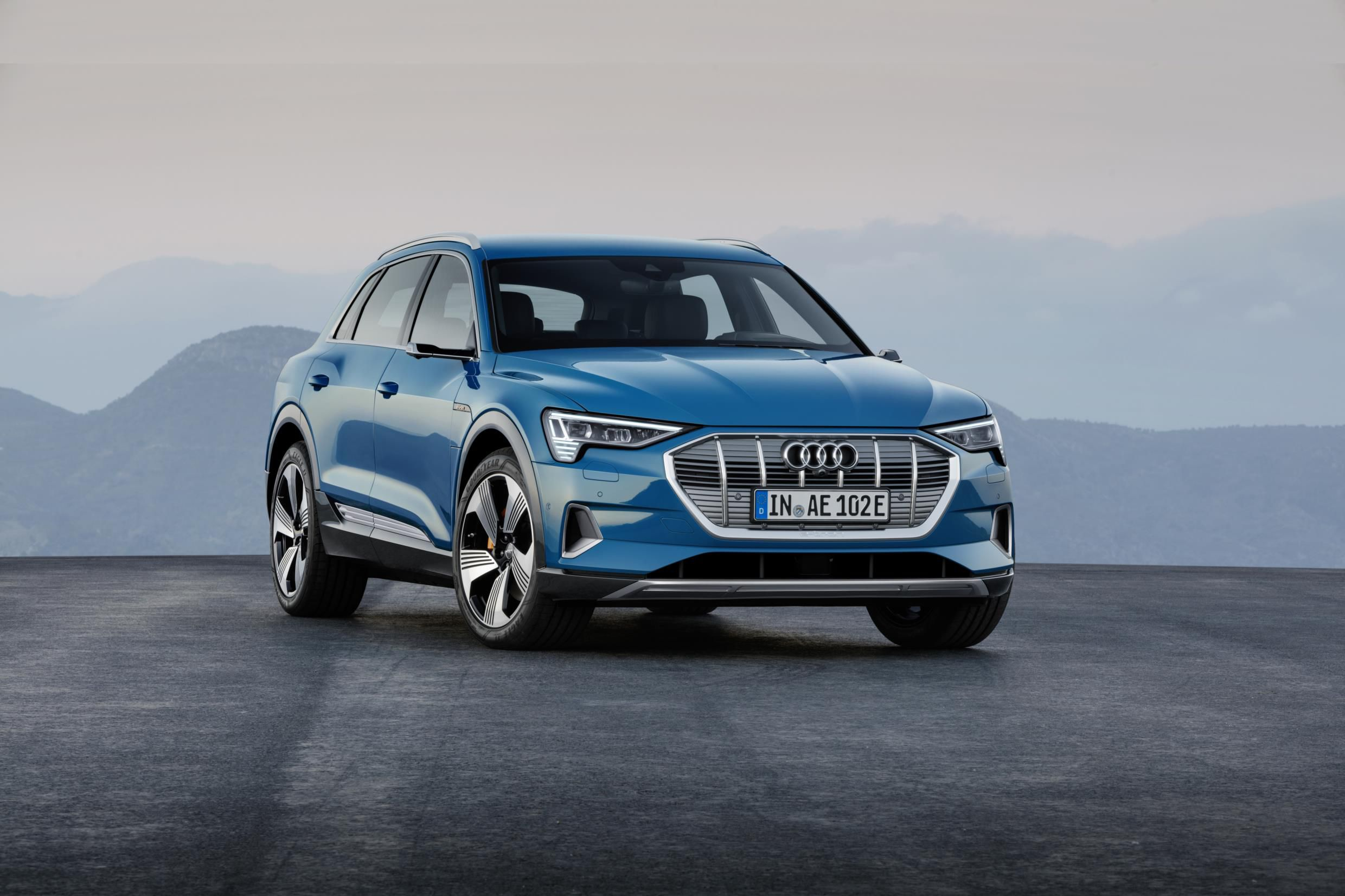 Blue Audi E-TRON parked two thirds side on