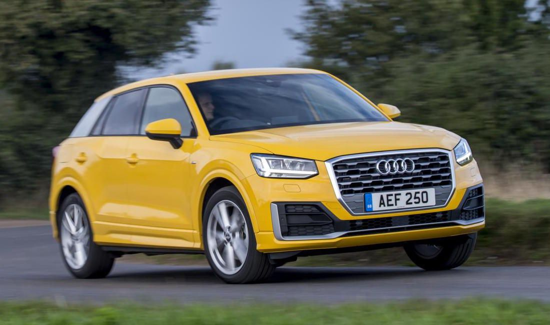 Yellow Audi Q2 driving to right