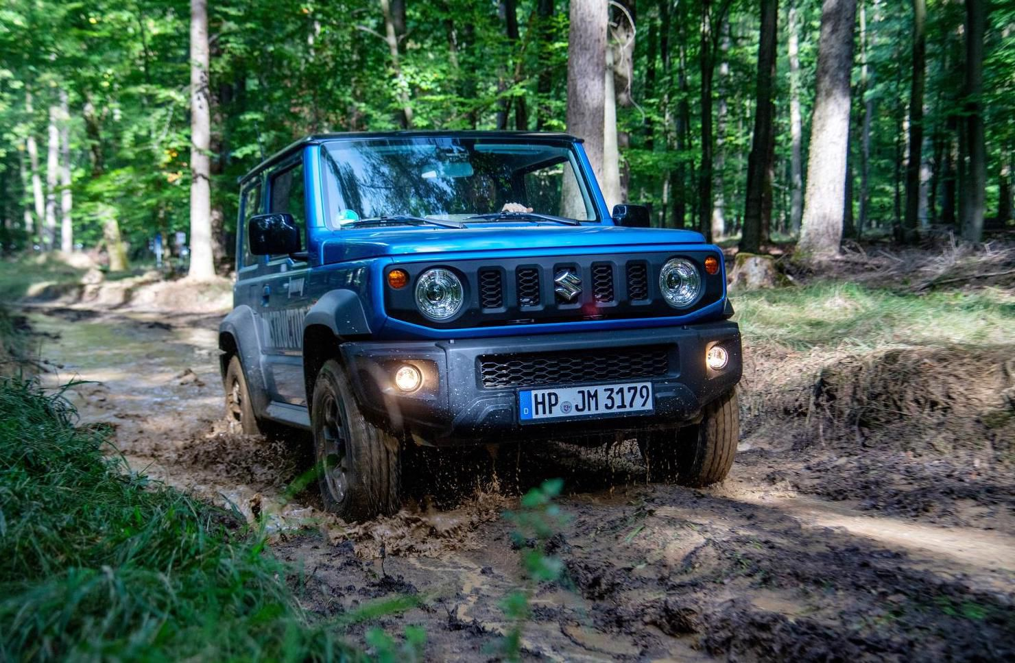 Suzuki Jimny driving through mud