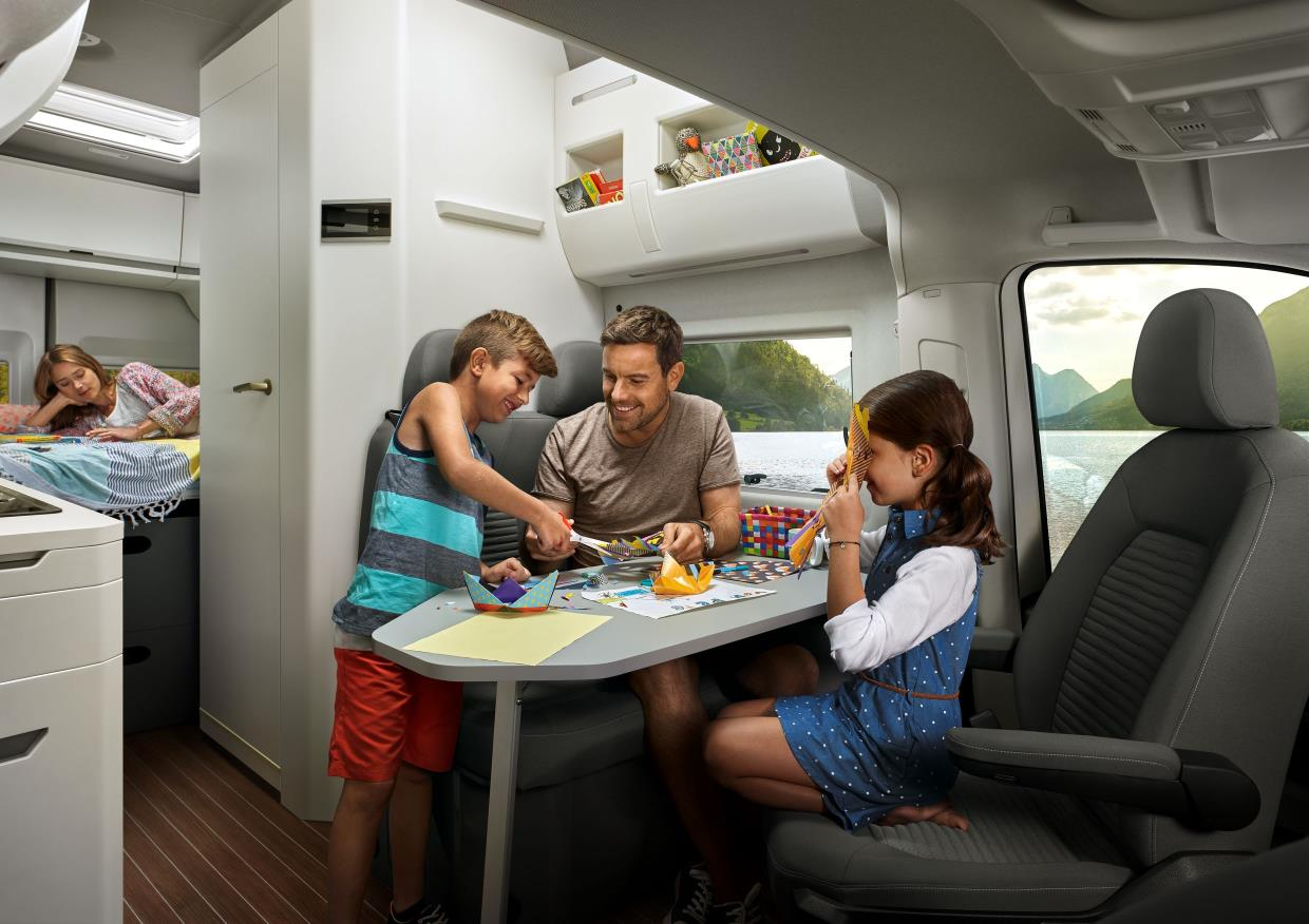 Famly enjoying the interior of the VW Grand California