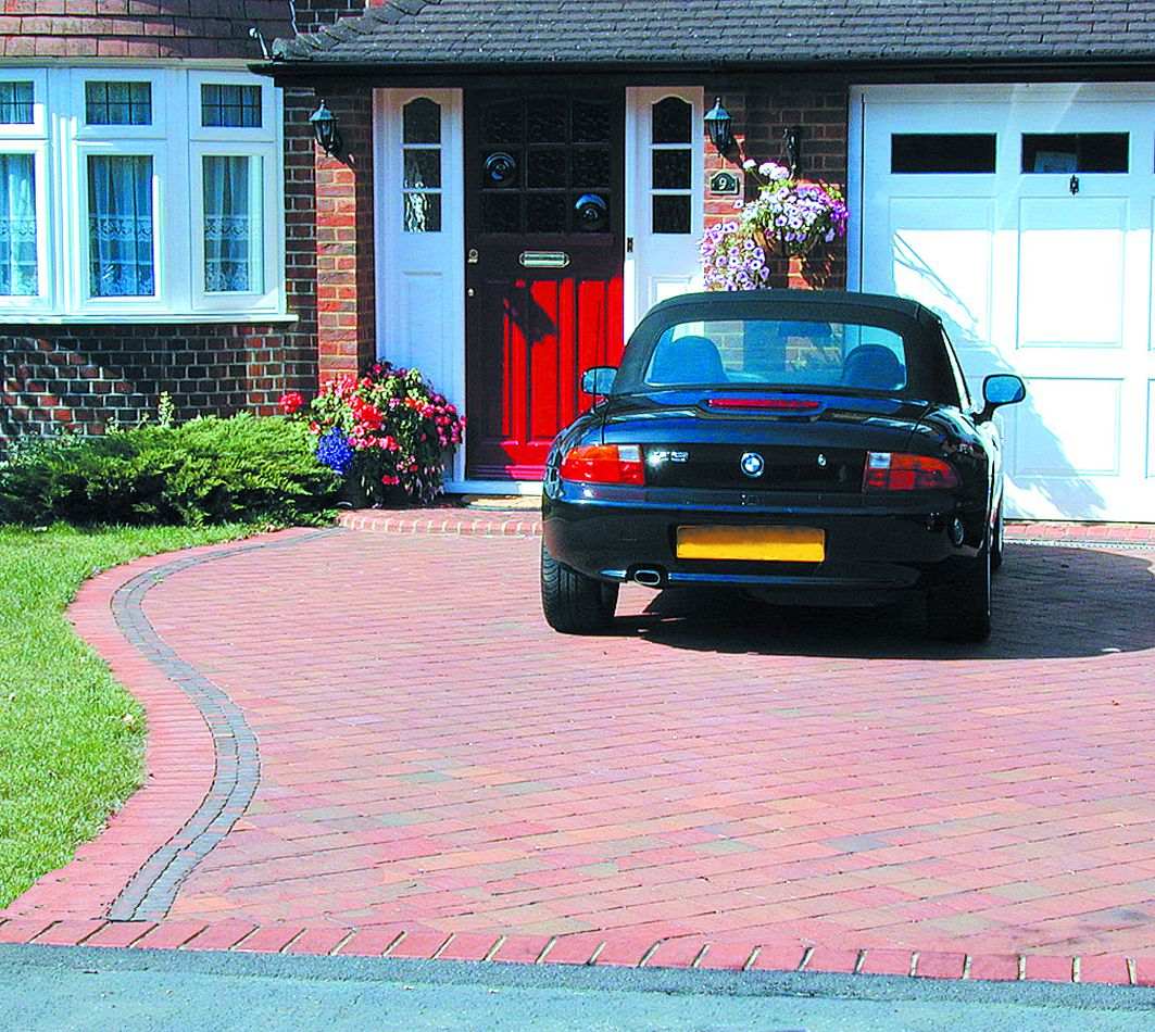 Car parked on a driveway.