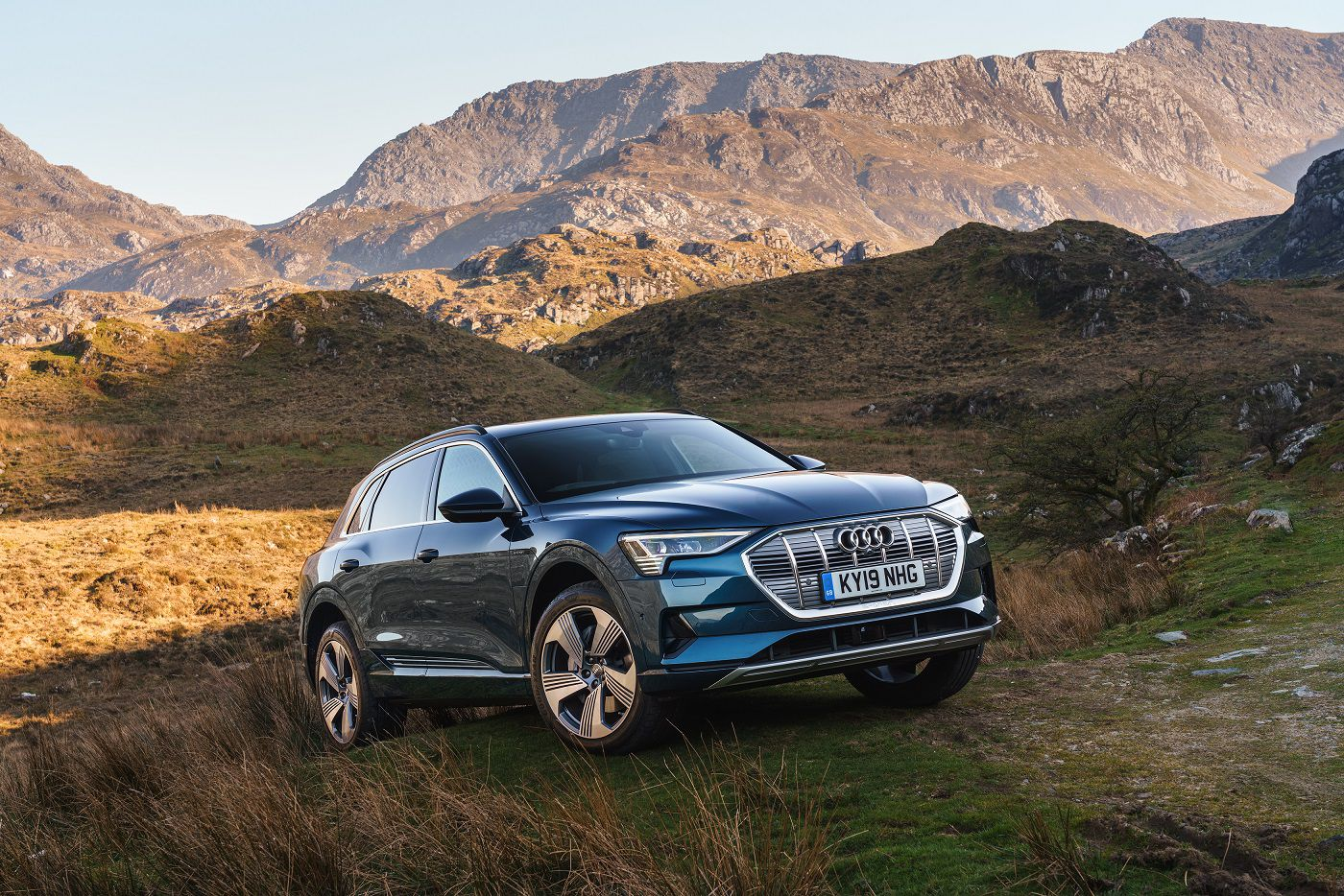 Audi e-tron in front of mountains