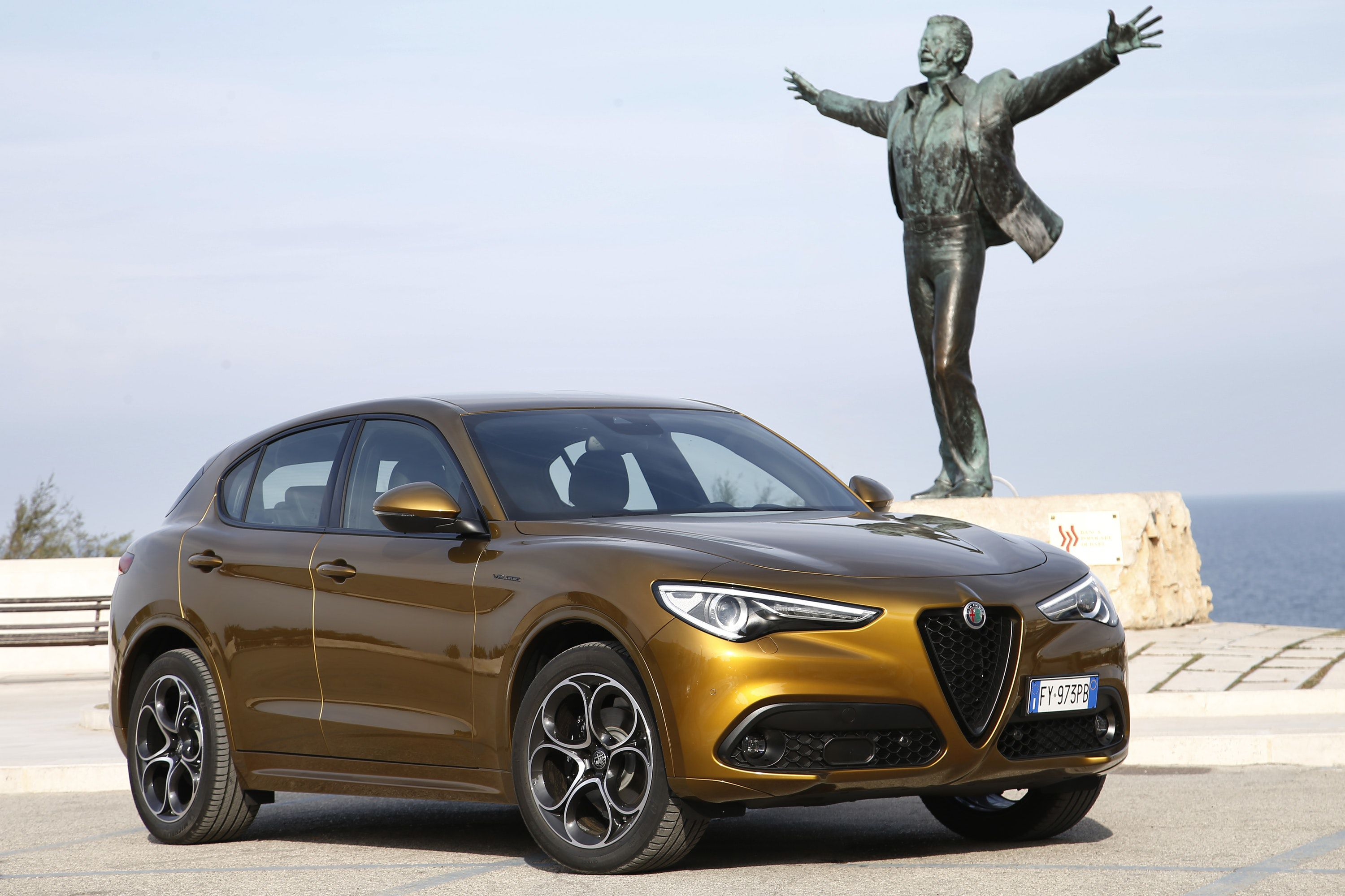 Alfa Romeo Stelvio parked in front of a Statue