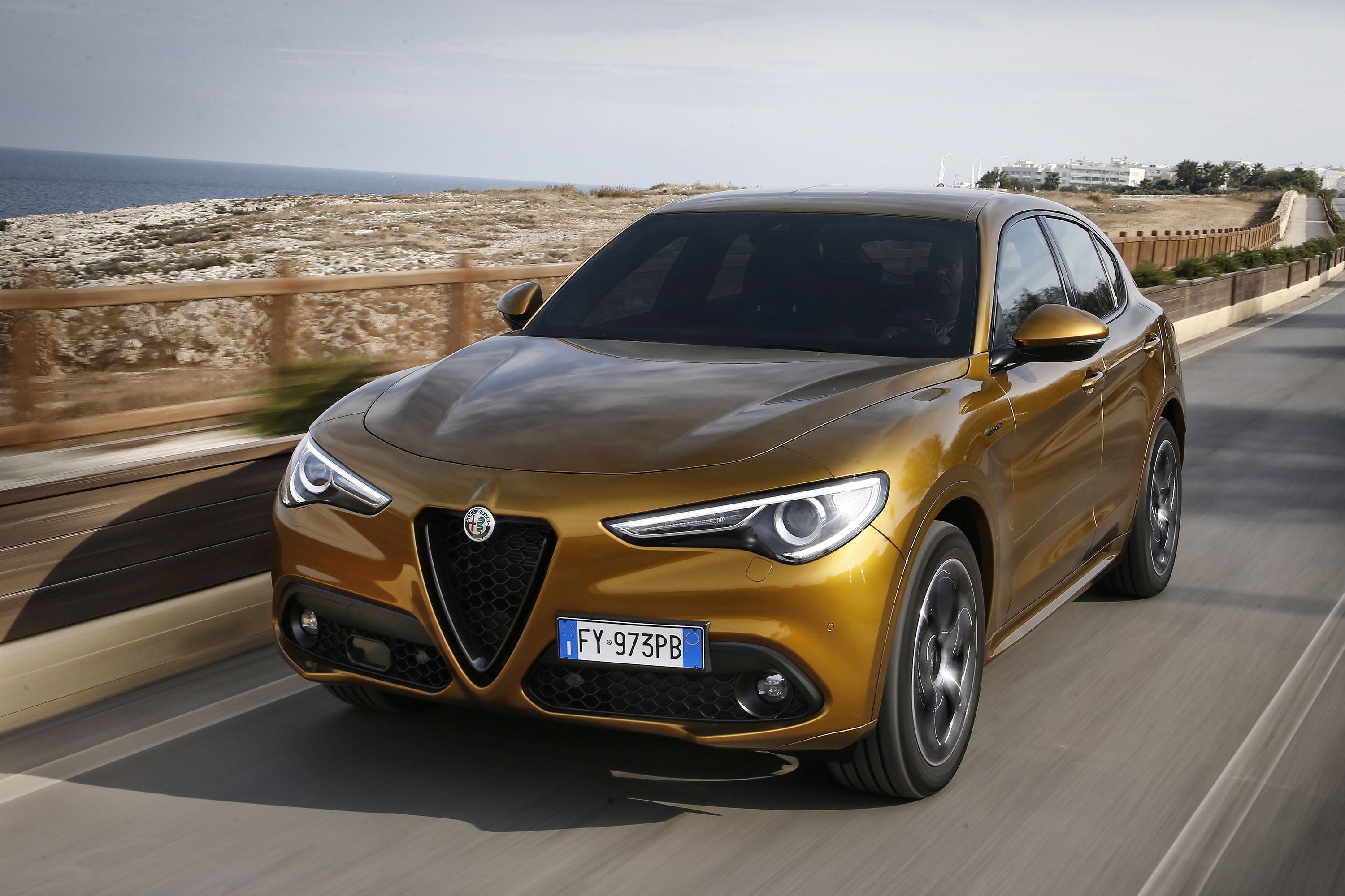 Front view of Alfa Stelvio driving on a road