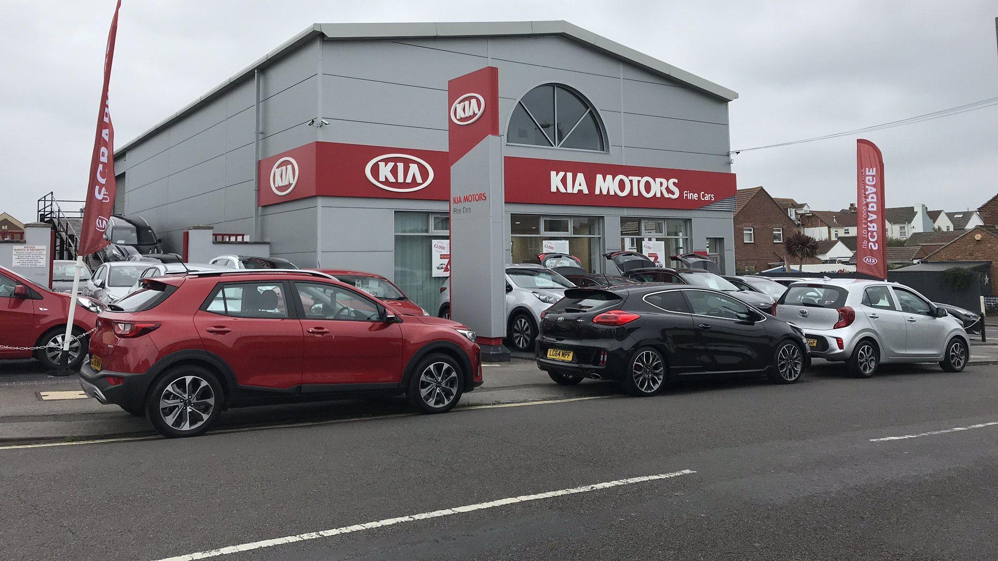 KIA Motors garage with cars outside