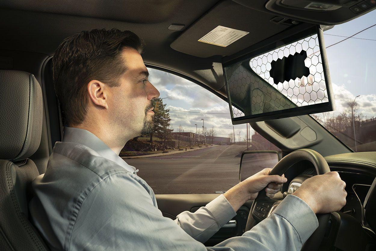Man driving with the bosch digital sunvisor