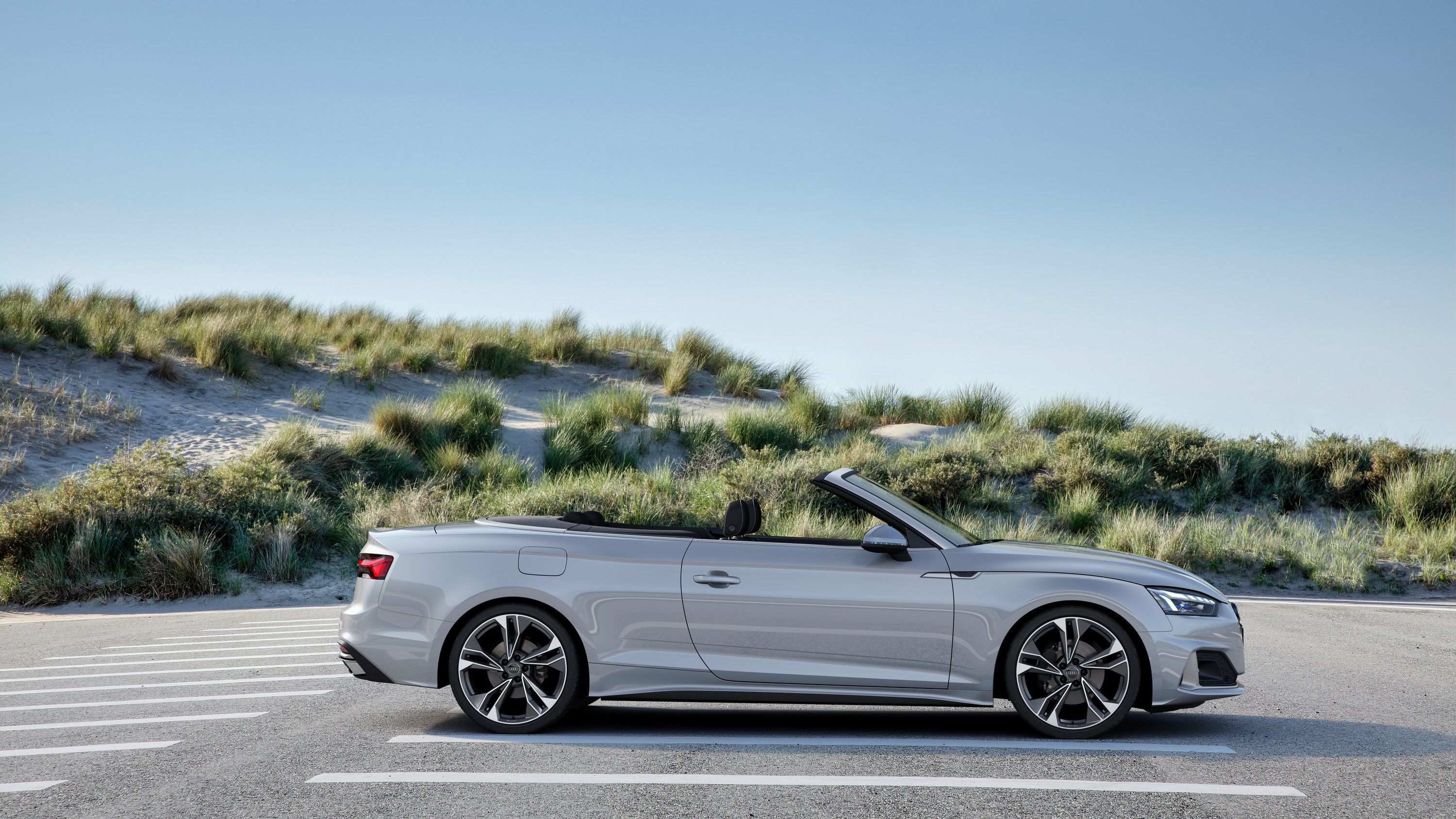 Audi A5 Convertible parked by sand dunes