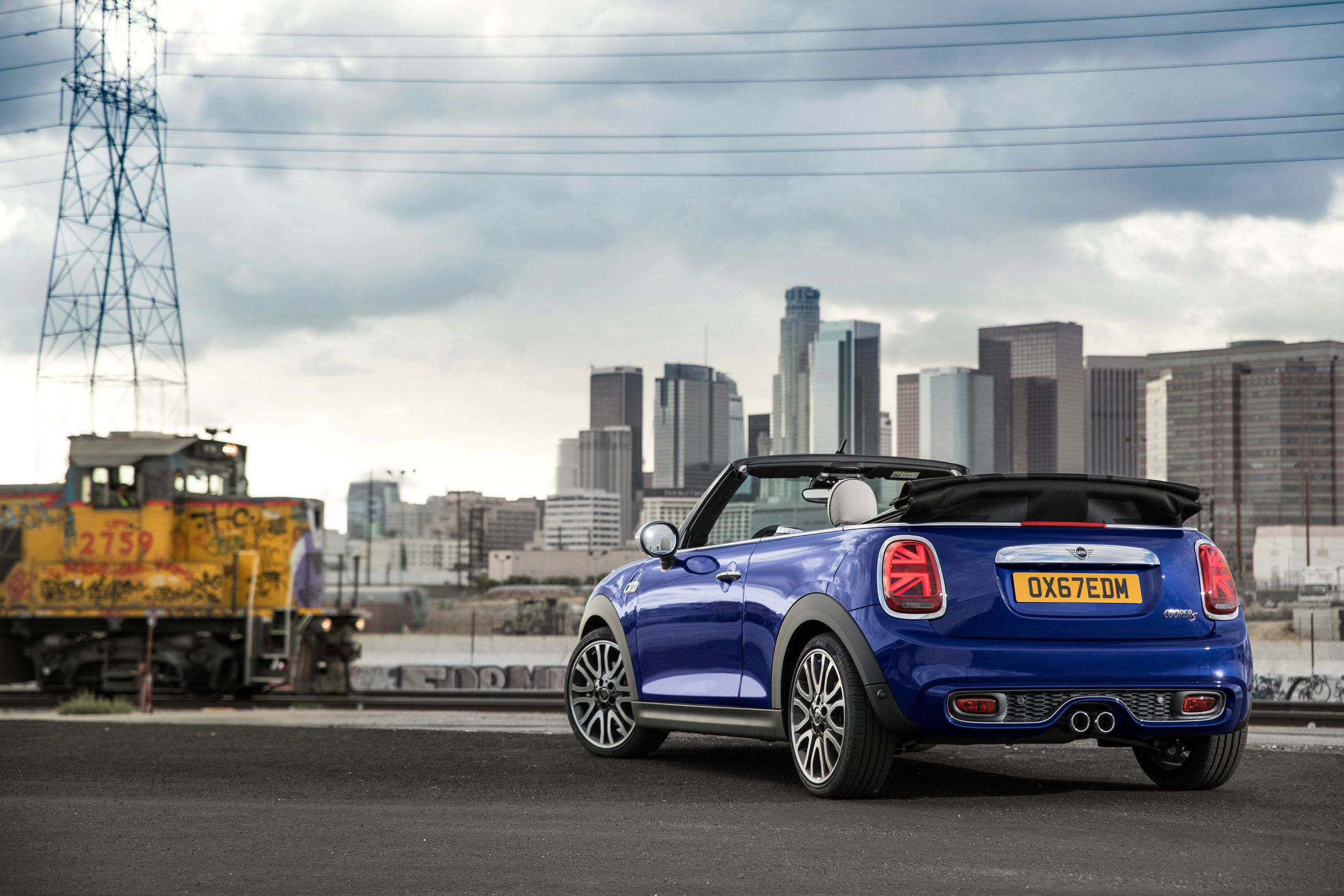 Blue mini parked by buildings