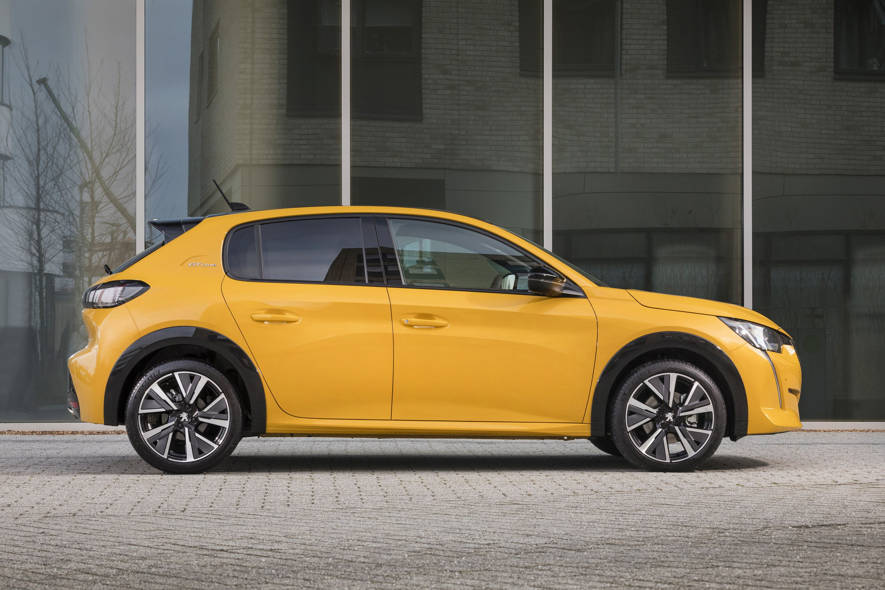 Side view of a Yellow Peugeot 208