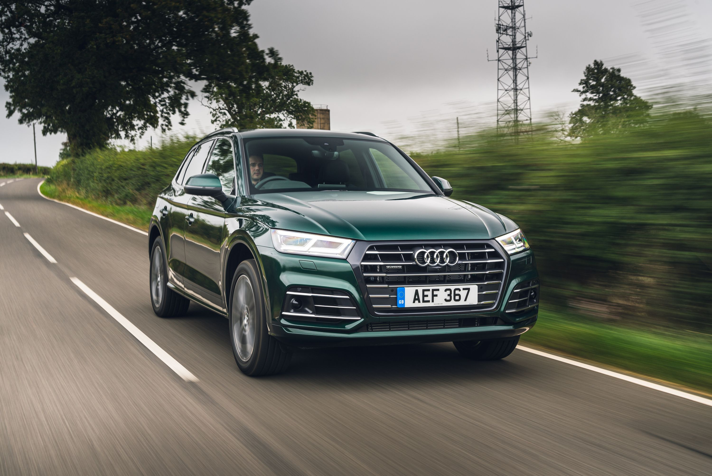 Green Q5 TFSI e driving on a road