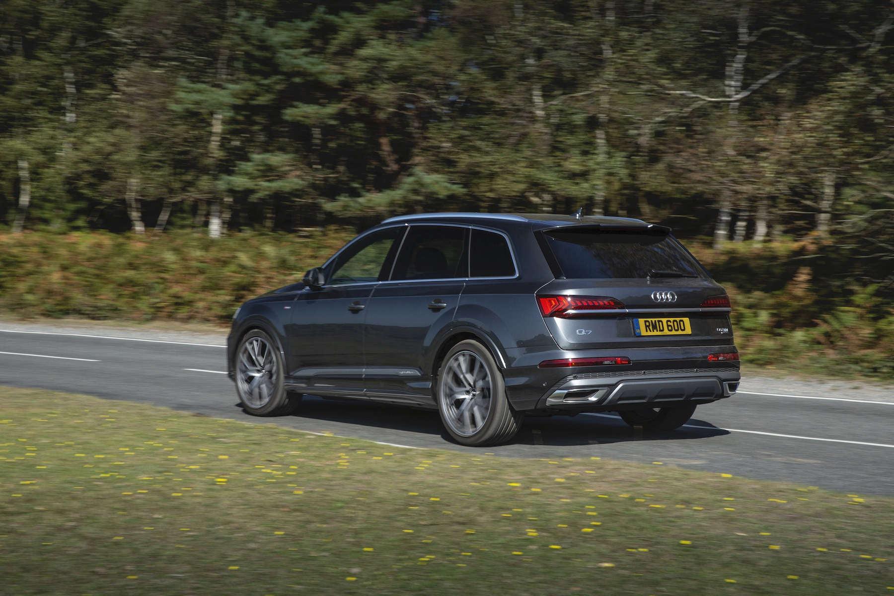 New Audi Q7 in grey from side on road
