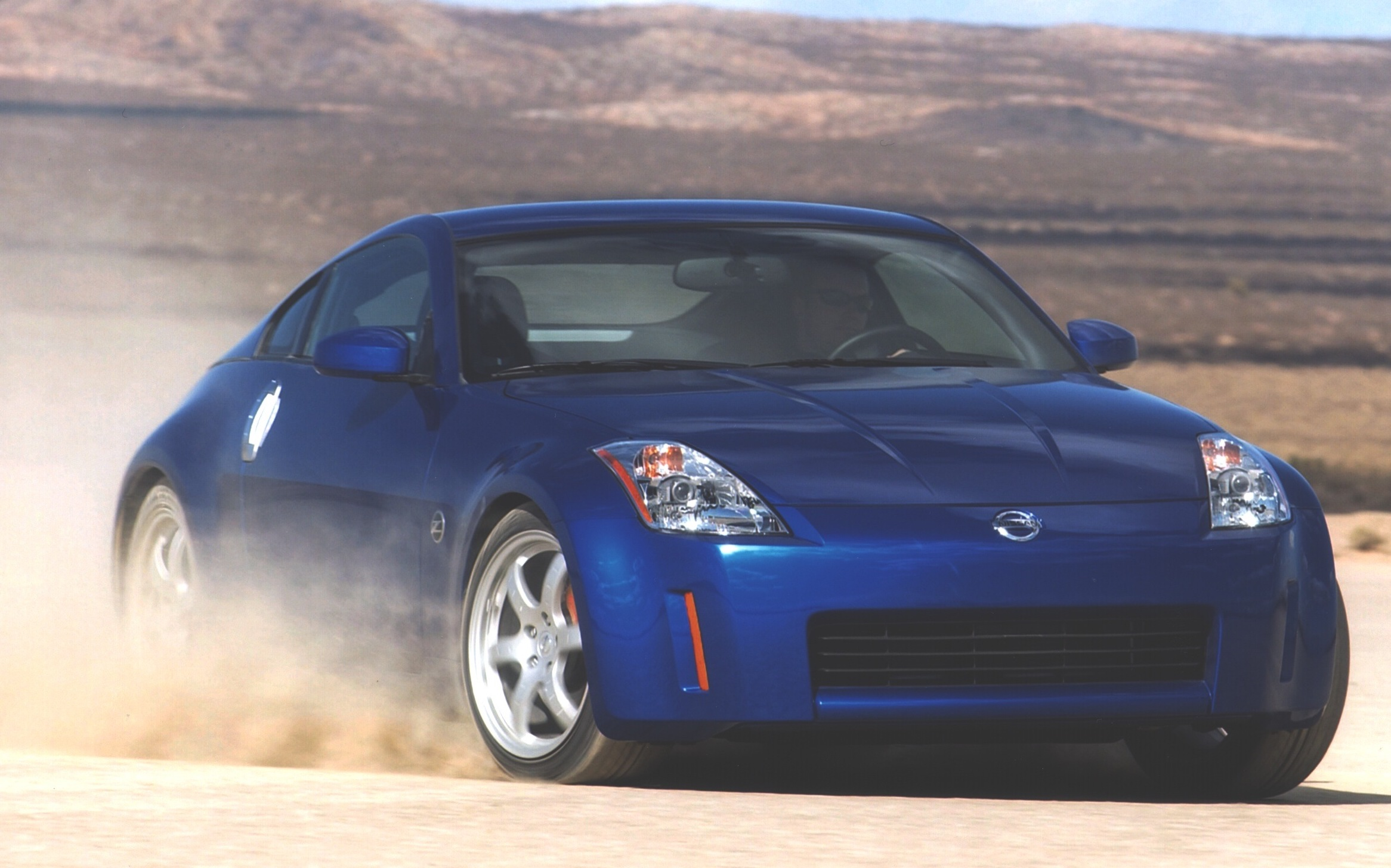 Nissan 350Z in front of mountains