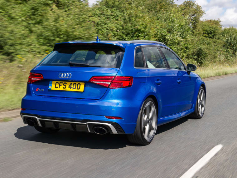 blue audi rs3 sportback driving on the road