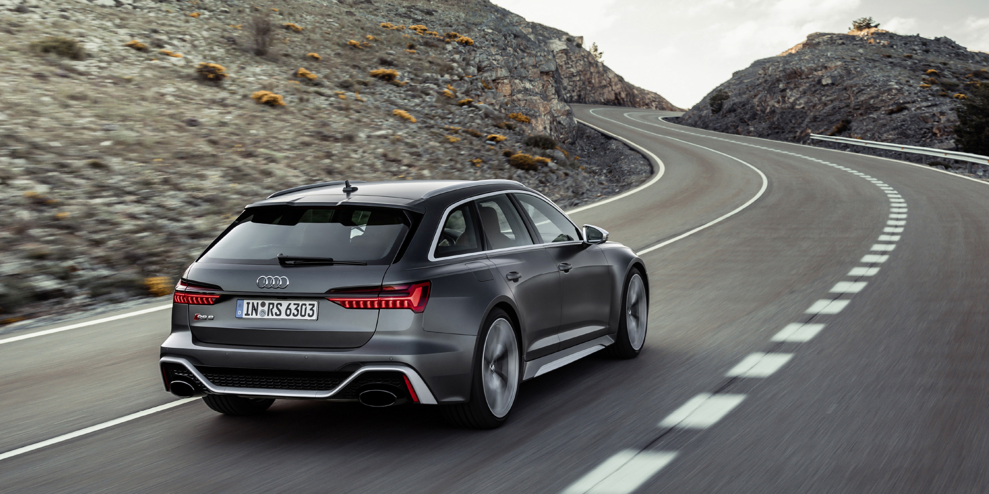 grey audi rs6 avant driving on the road