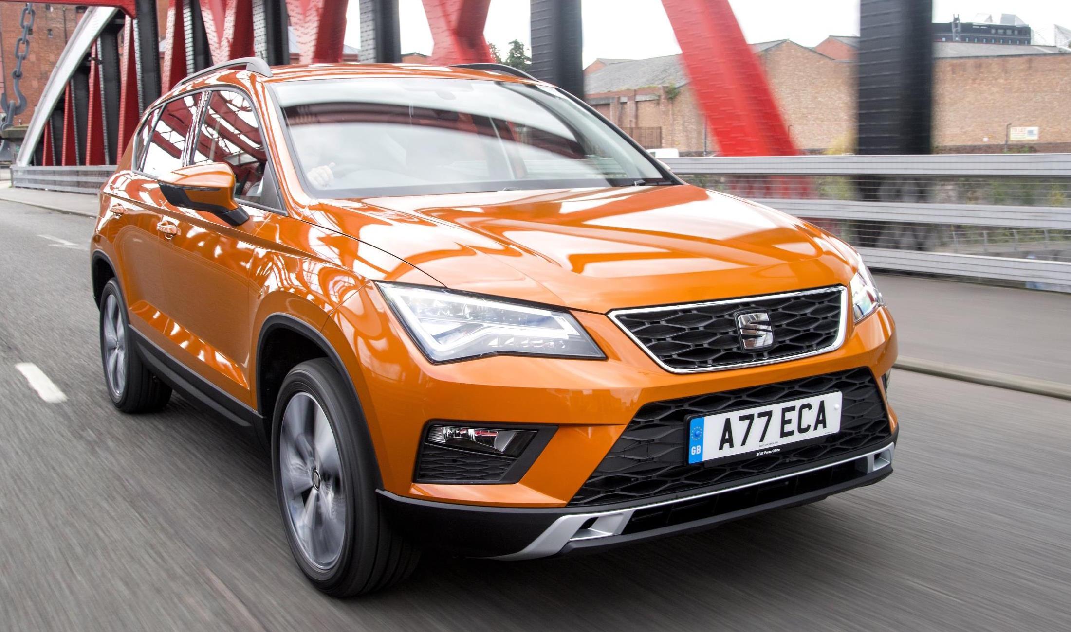 Orange SEAT Ateca driving ¾ to right