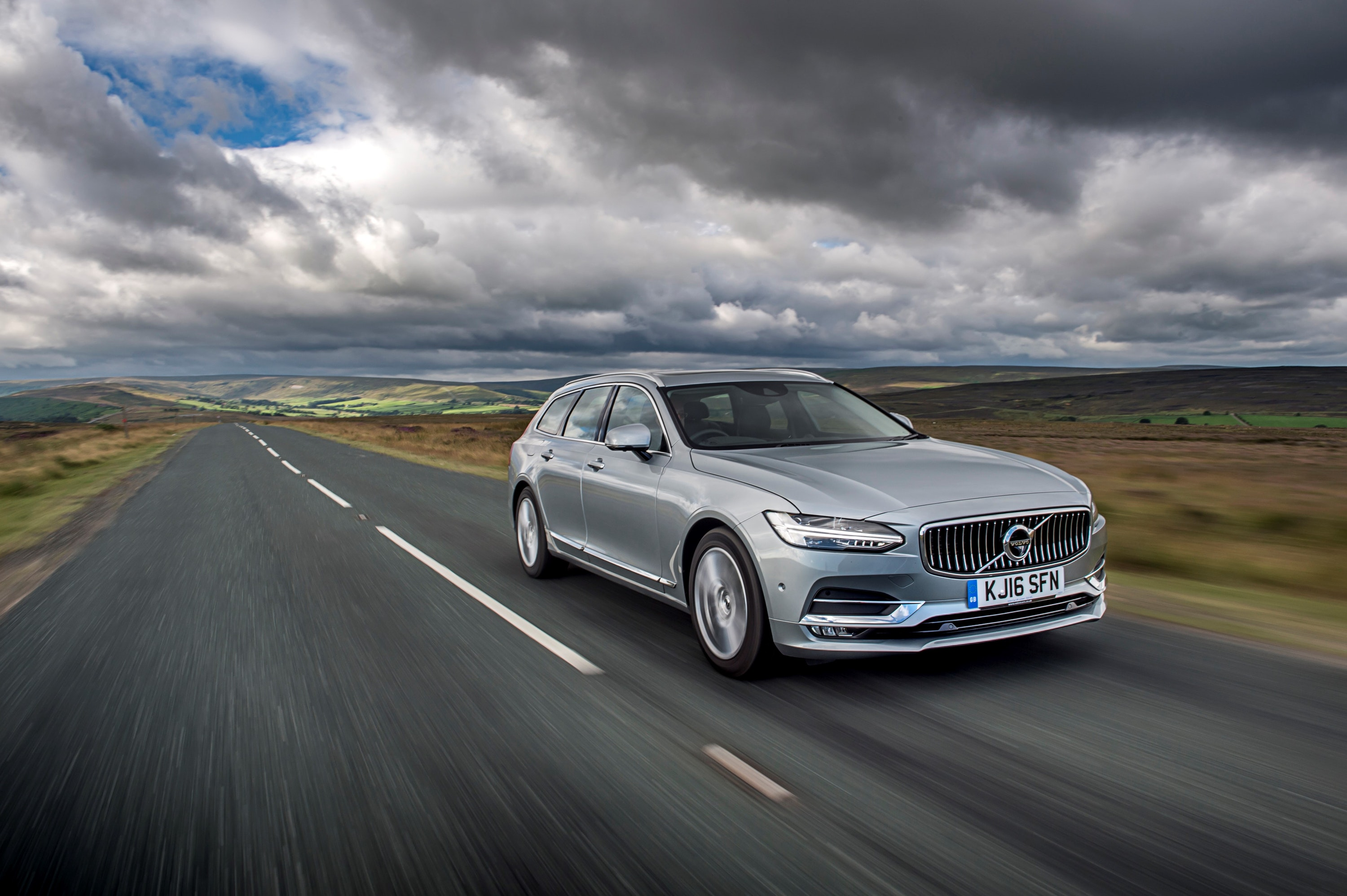 Silver Volvo V90 driving on a road