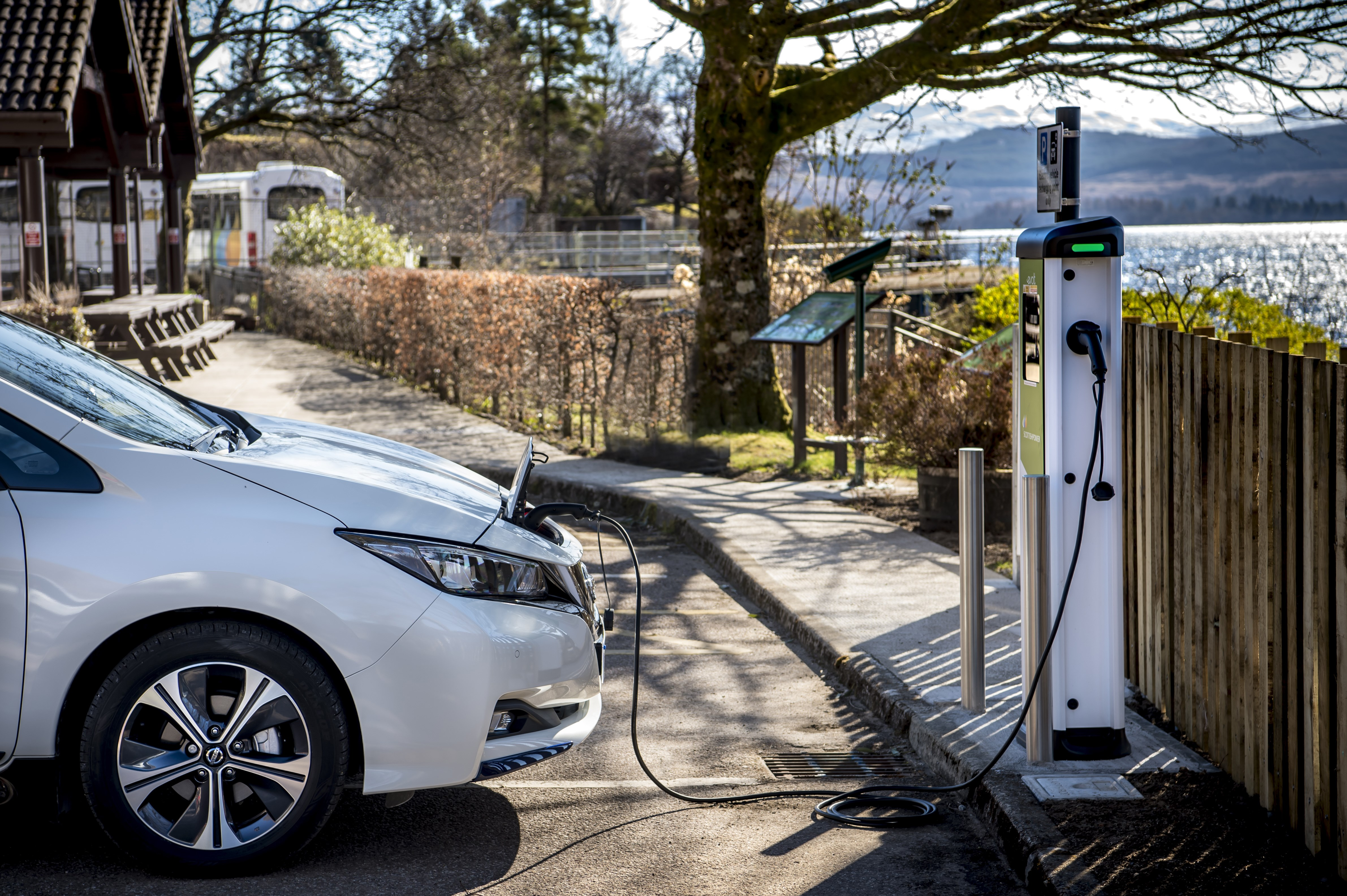 electric car plugging in to charge