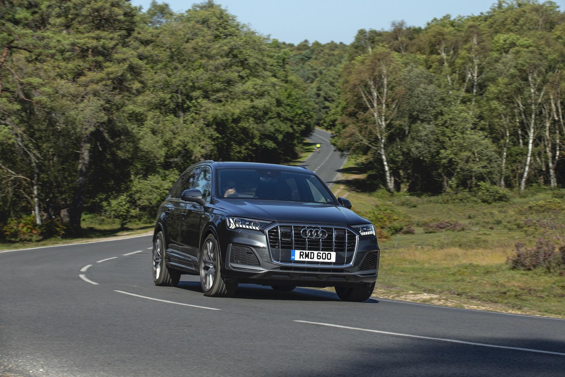 Black Audi Q7 on the road