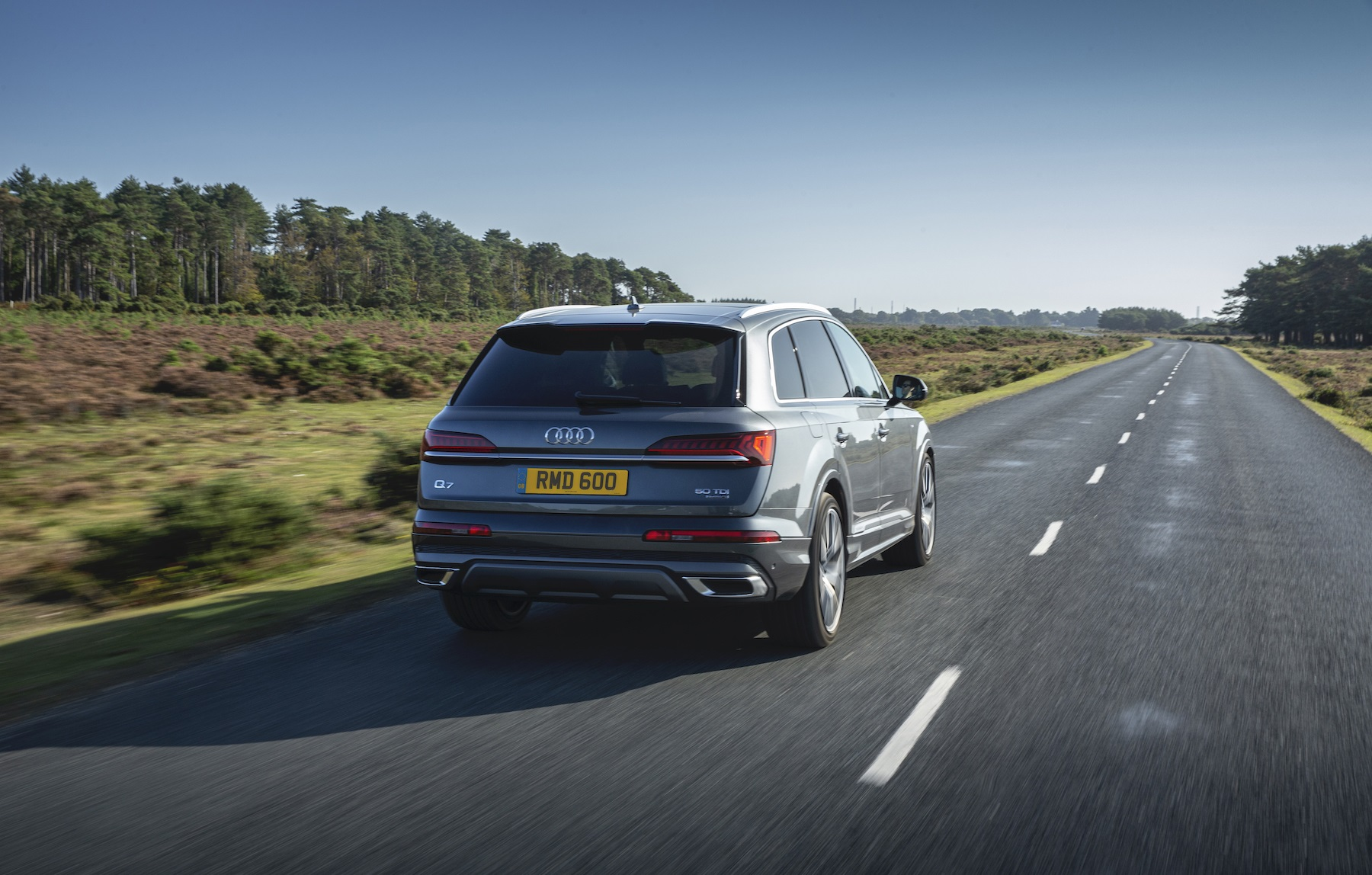 Grey Audi Q7 reas on the road