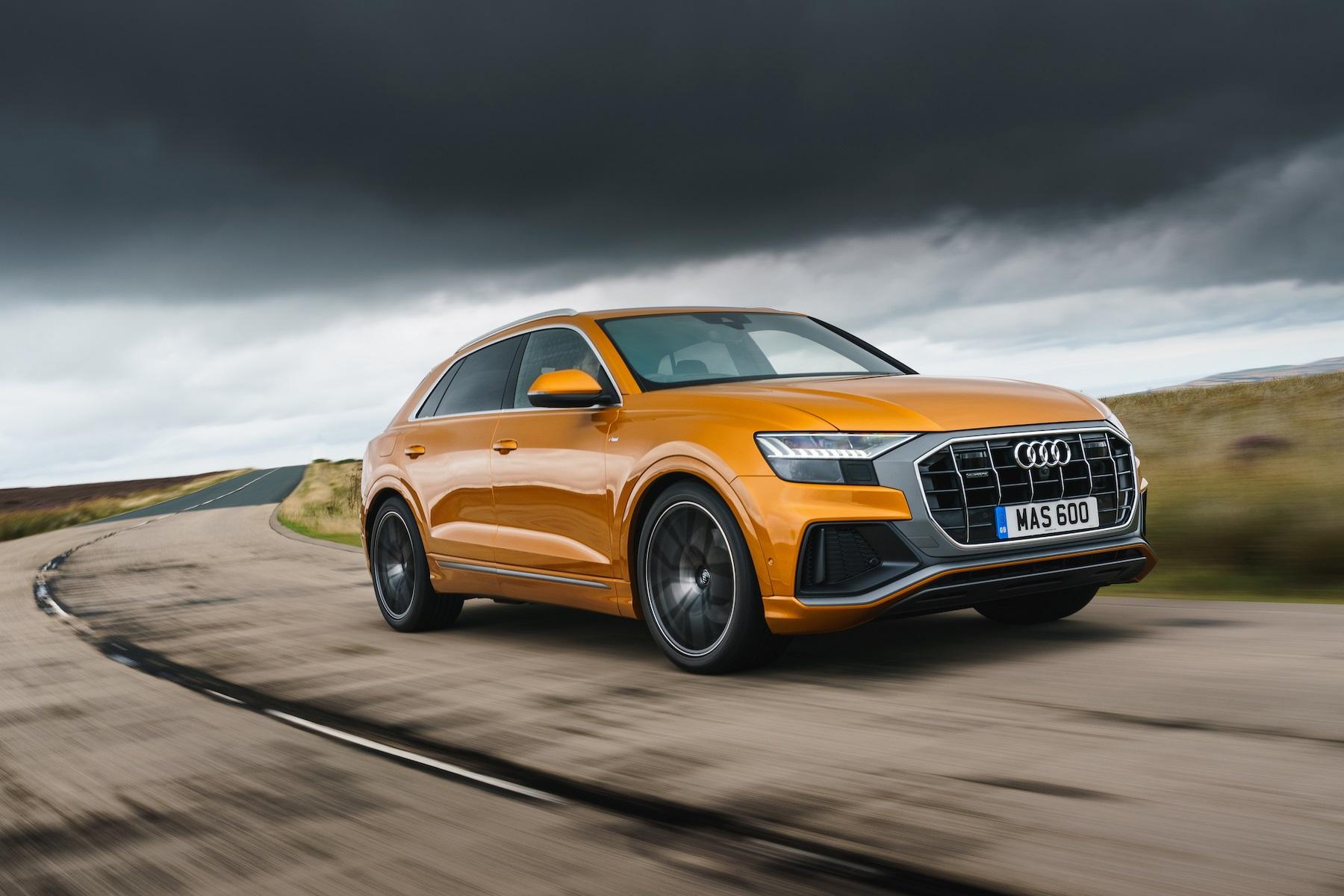 Orange Audi Q8 on the road