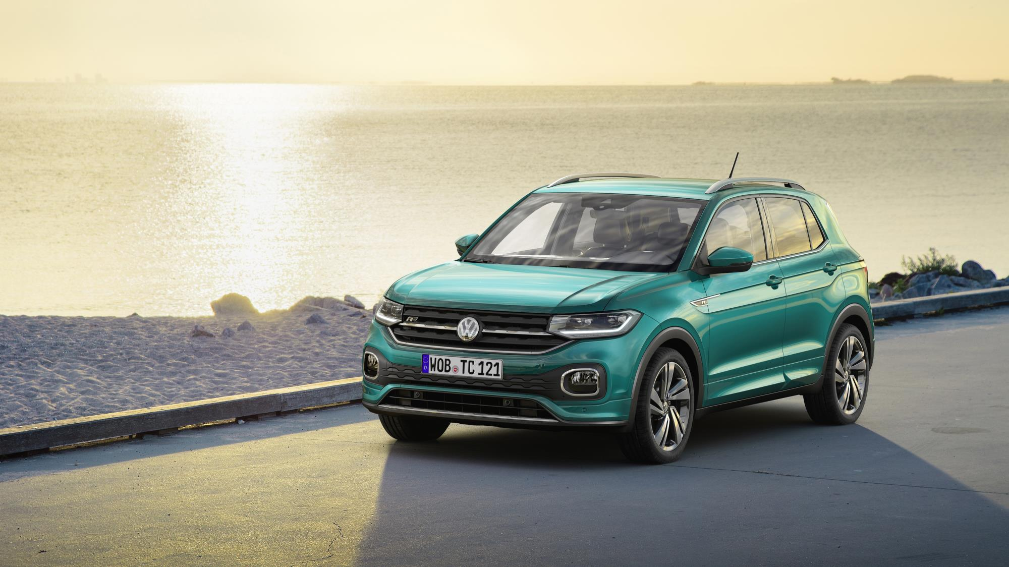 Turquoise blue green metallic VW T-Cross with beautiful sunset
