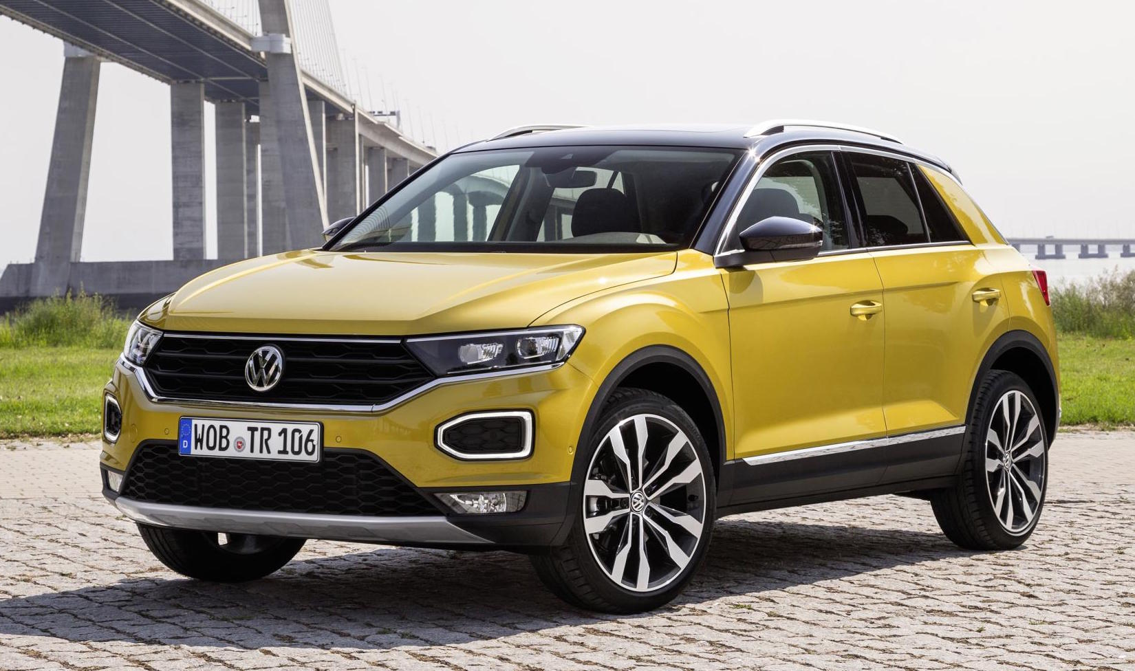 Yellow VW T-Roc parked facing ¾ to left