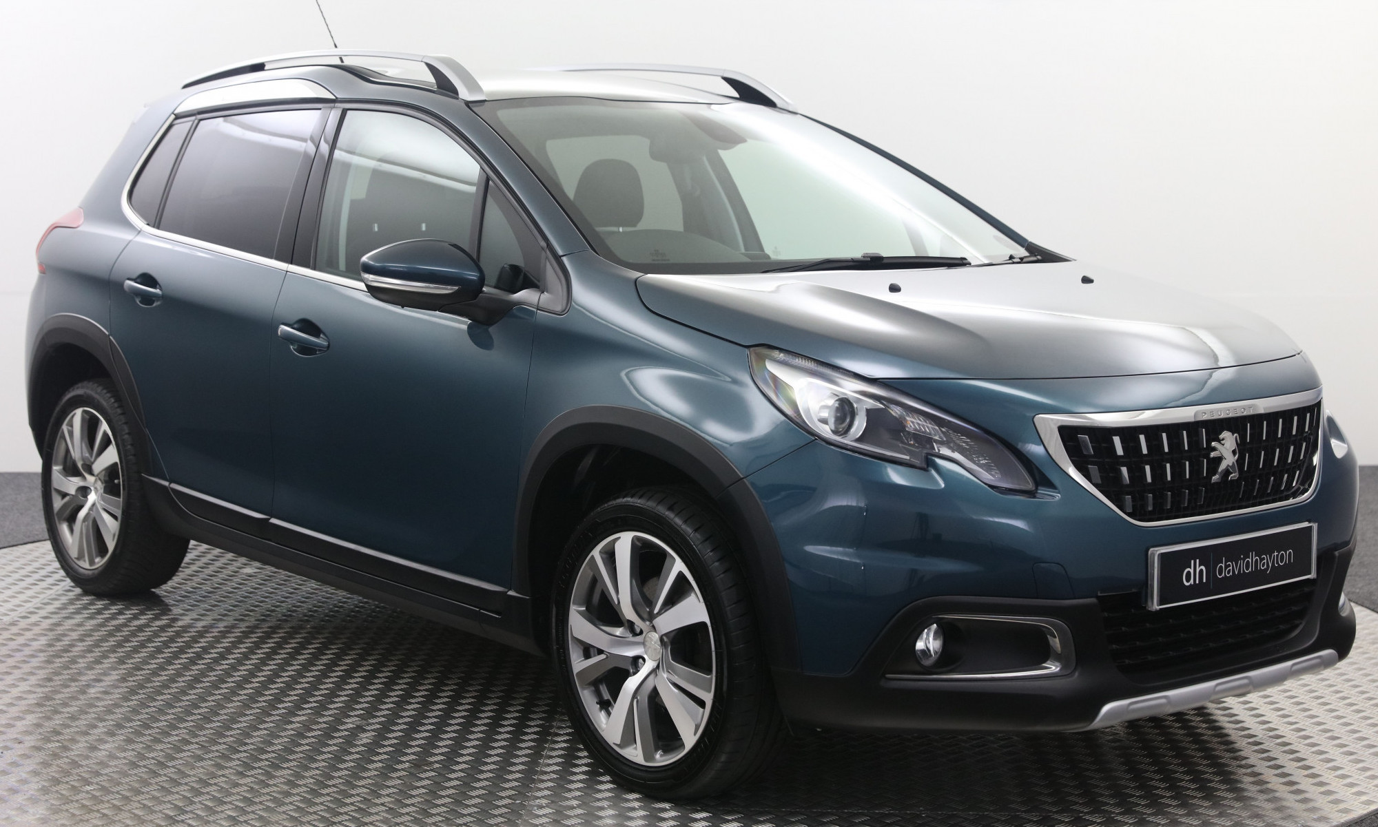 Blue Peugeot 2008 facing 3/4 right