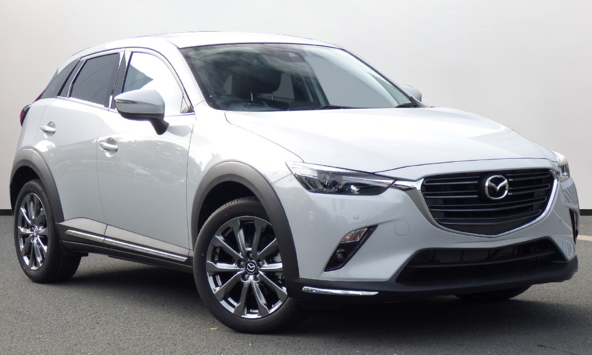 White Mazda CX-3 facing 3/4 right